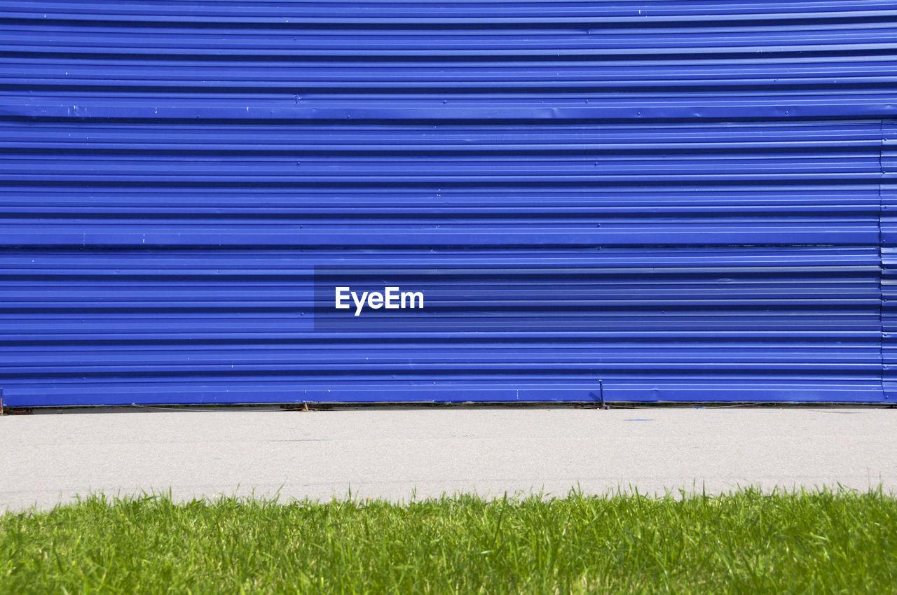 Closed Blue Shutter By Field