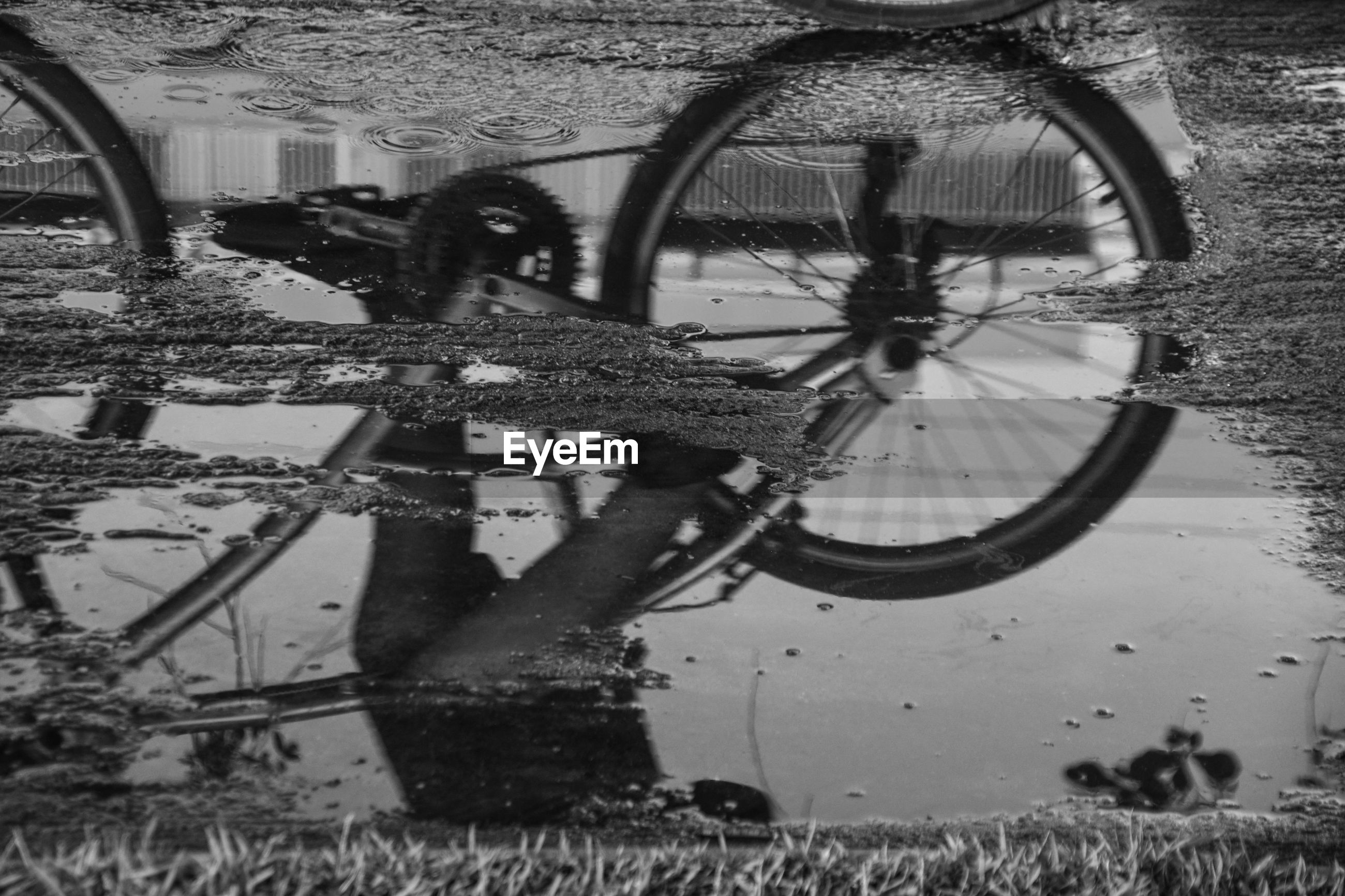 Reflection of bicycle on puddle