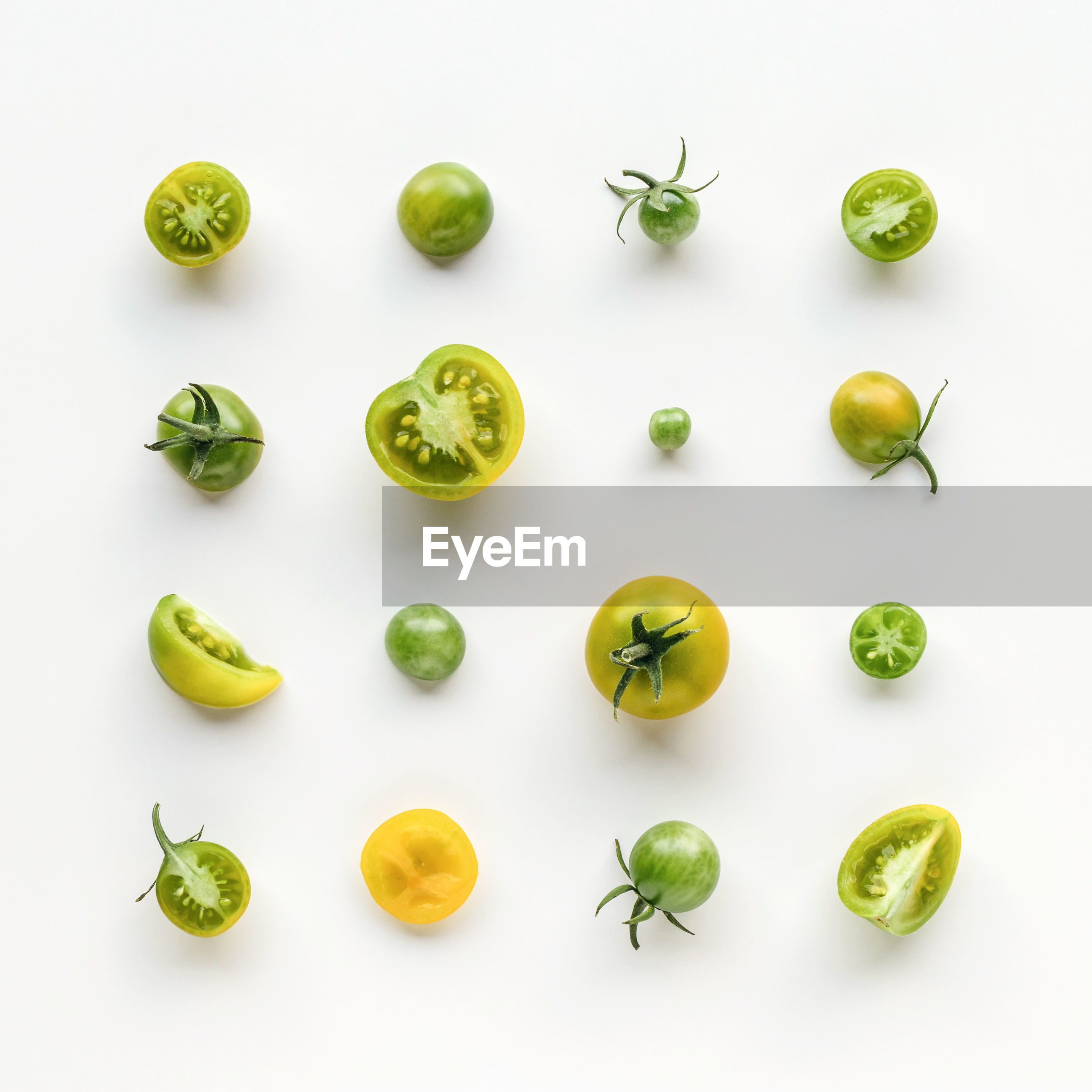 Directly above shot of tomatoes on white background