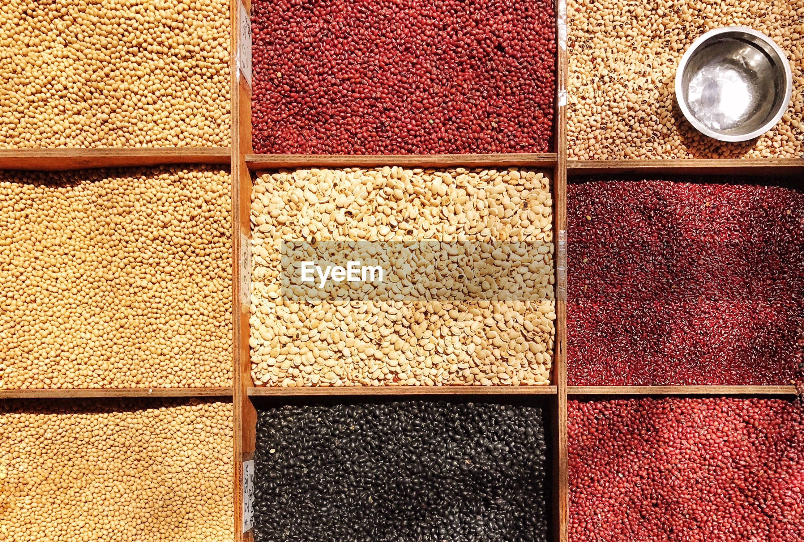 Directly above shot of various grains for sale at market