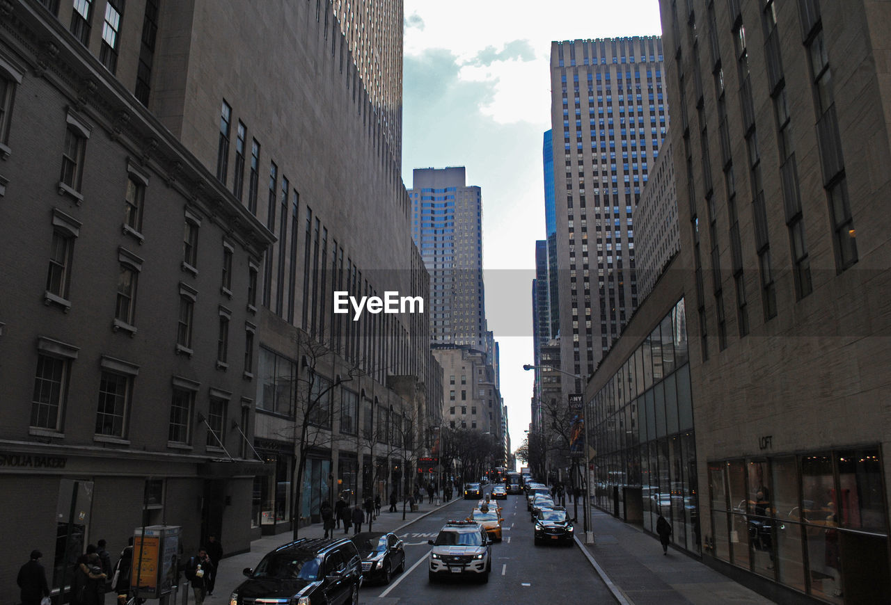 VIEW OF CITY STREET AMIDST BUILDINGS