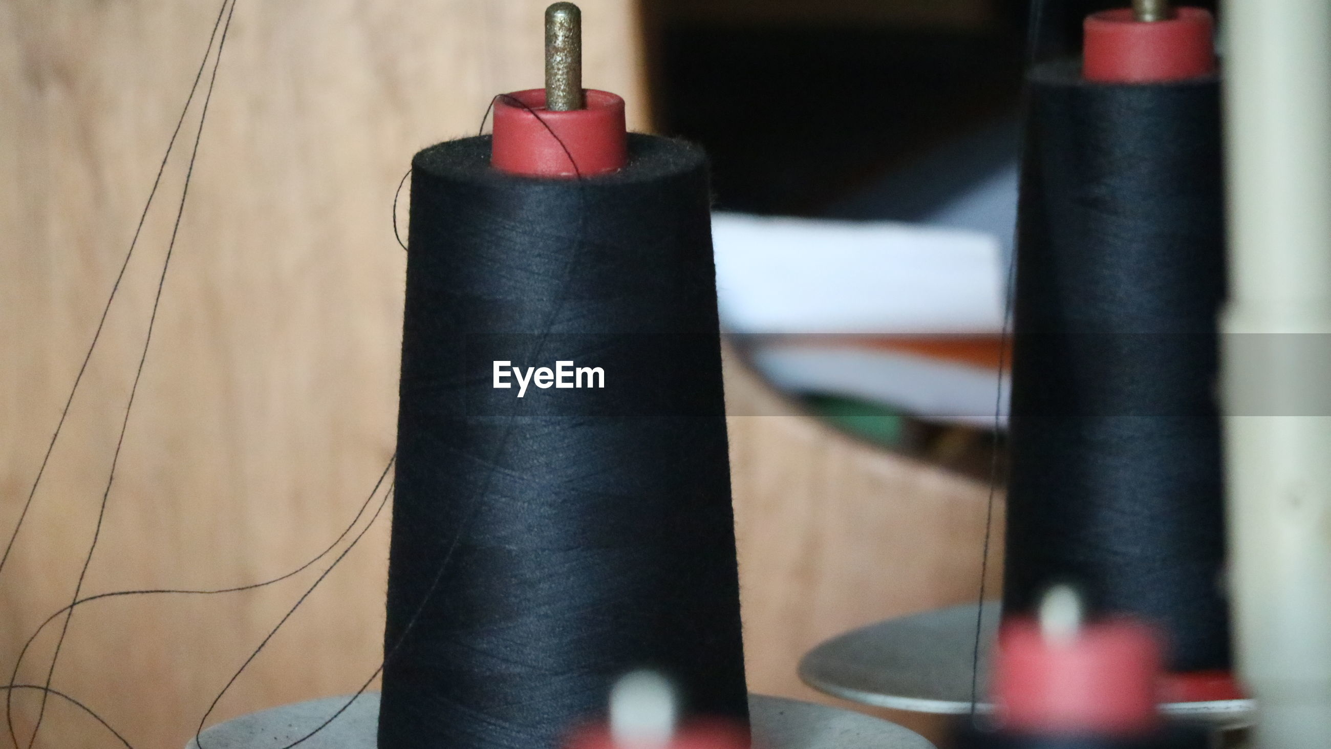 Close-up of spool in textile factory