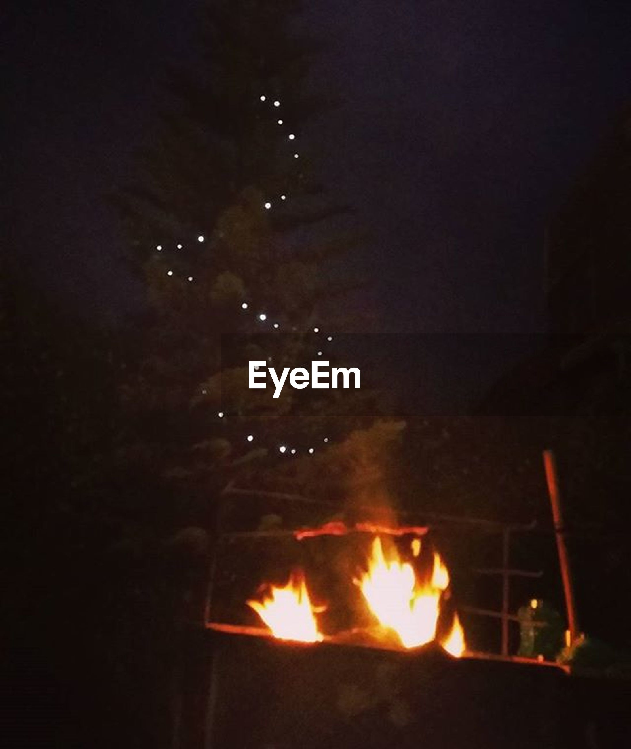 burning, fire - natural phenomenon, flame, heat - temperature, night, illuminated, glowing, bonfire, fire, heat, firewood, dark, campfire, light - natural phenomenon, motion, fireplace, smoke - physical structure, outdoors, no people
