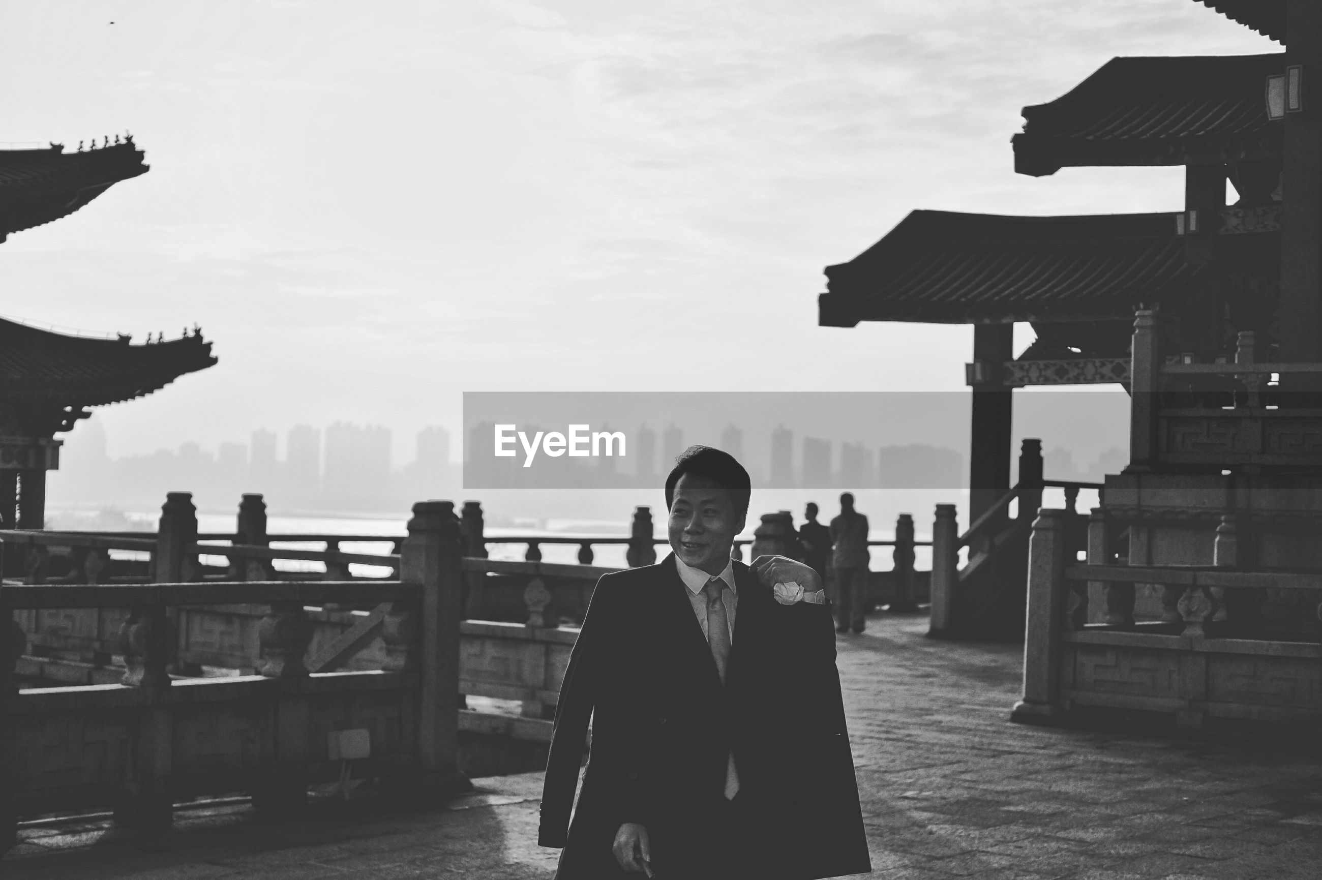 Businessman standing at pavilion of prince teng against sky
