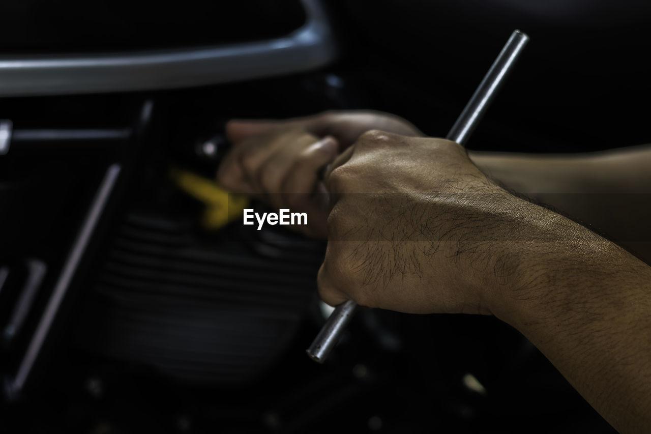 High angle view of man repairing car