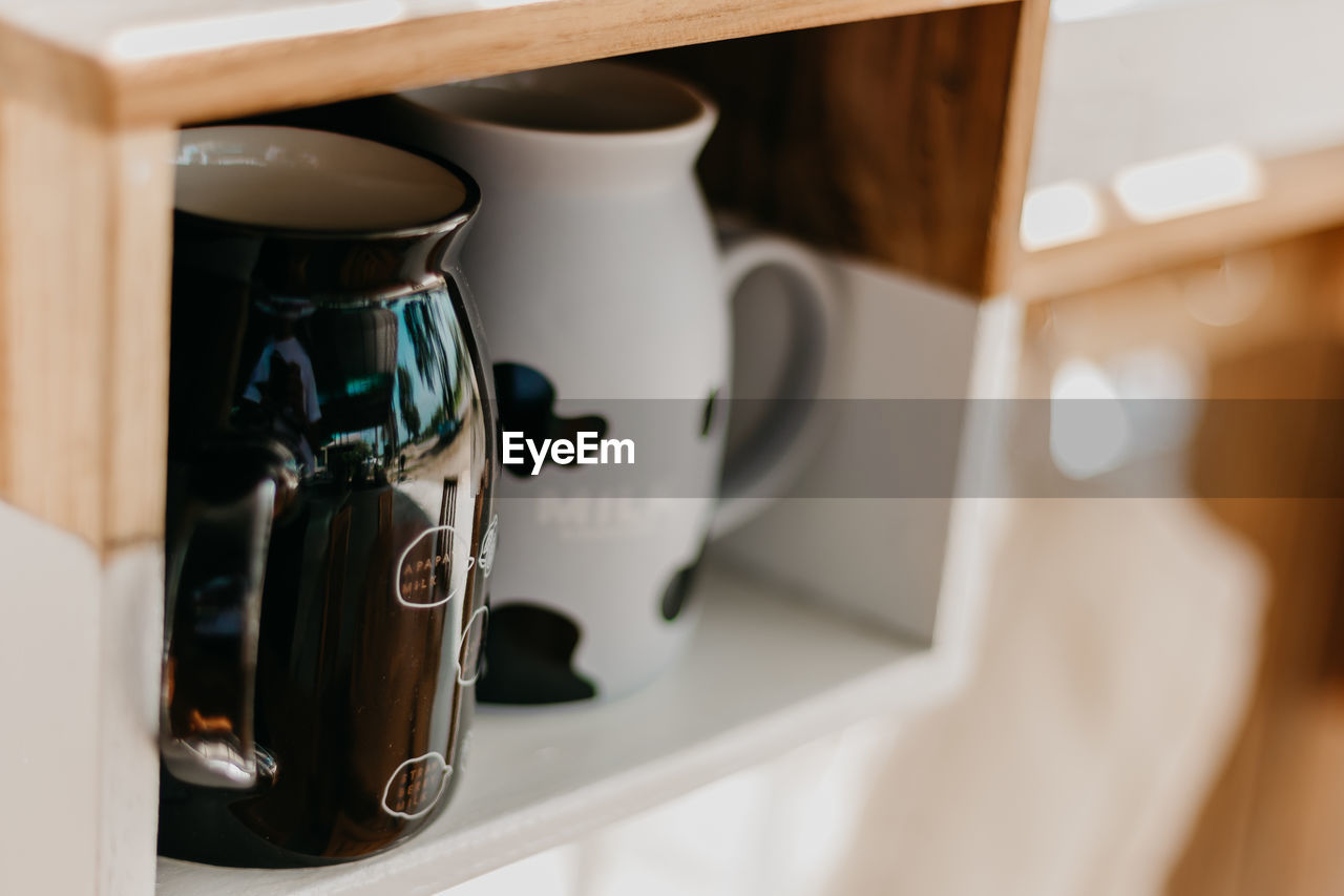 indoors, cup, coffee, coffee - drink, mug, close-up, coffee cup, no people, coffee maker, food and drink, focus on foreground, appliance, drink, still life, white color, domestic room, home, espresso maker, refreshment, machinery, coffee pot, crockery