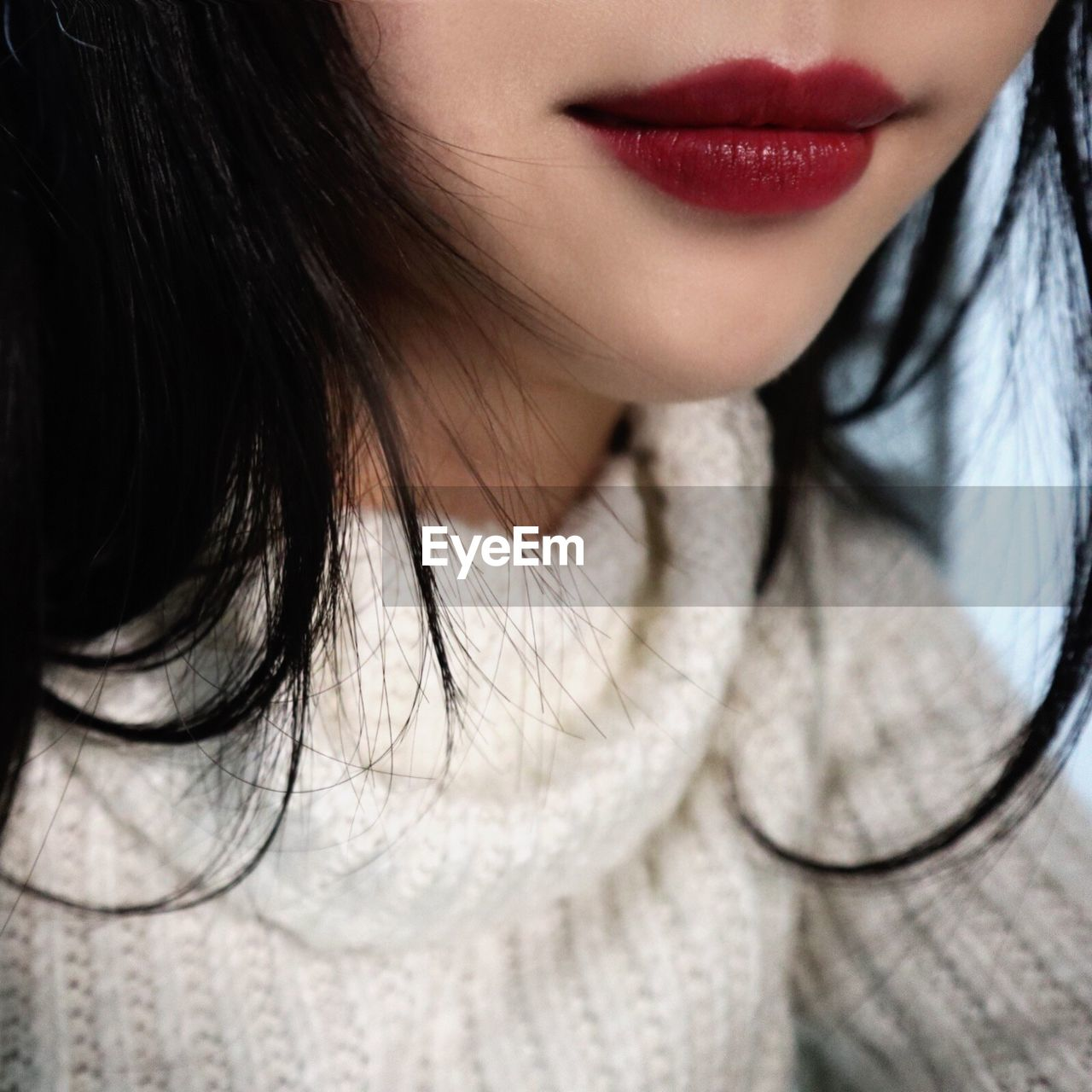 Midsection Of Young Woman With Red Lipstick