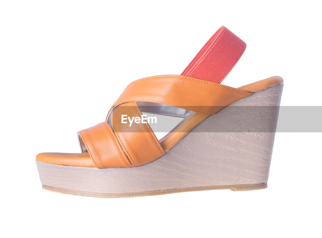 Close-up of sandal against white background