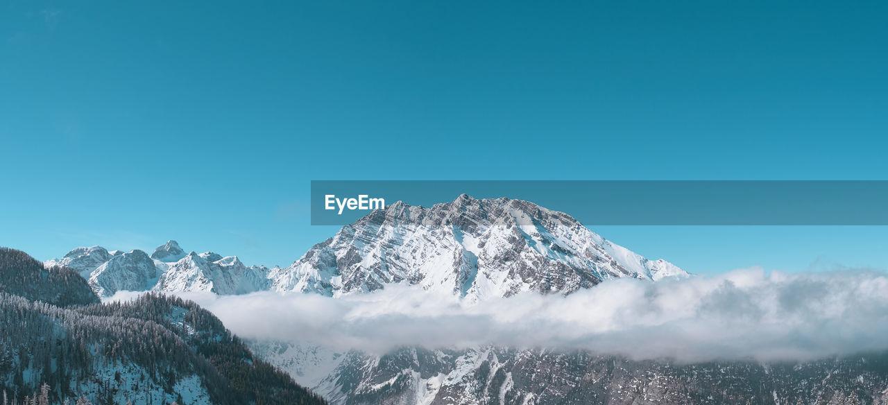 SNOWCAPPED MOUNTAIN AGAINST BLUE SKY
