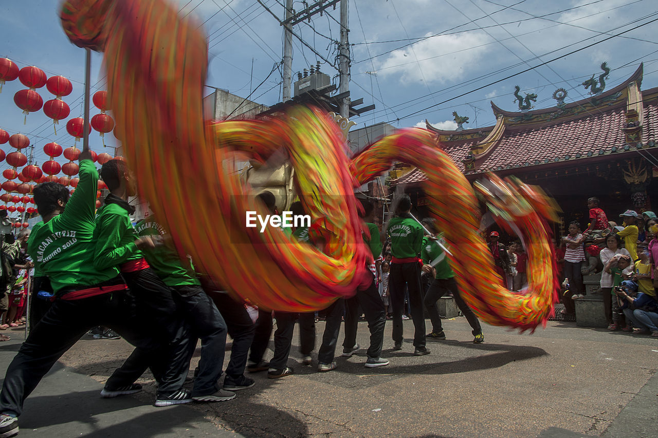 group of people, celebration, men, real people, multi colored, leisure activity, crowd, sky, people, day, traditional festival, nature, adult, lifestyles, city, architecture, arts culture and entertainment, outdoors, festival, carnival - celebration event