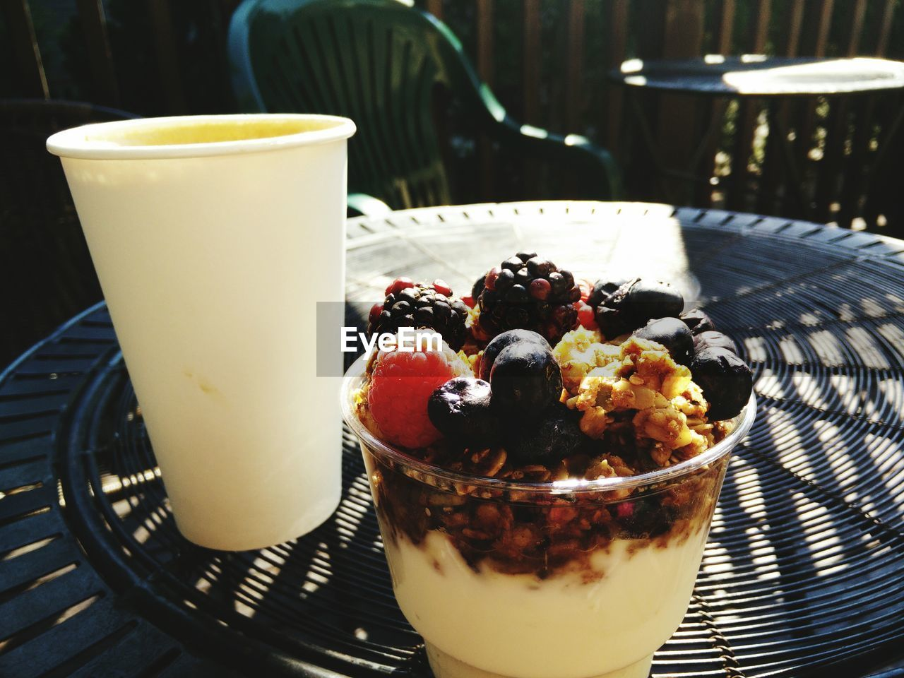 Close-up of berries and granola in glass on table