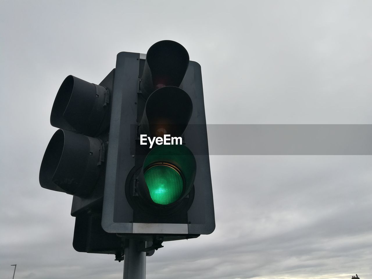 sky, sign, light, cloud - sky, stoplight, road signal, low angle view, safety, nature, communication, no people, guidance, illuminated, outdoors, security, day, green light, green color, protection