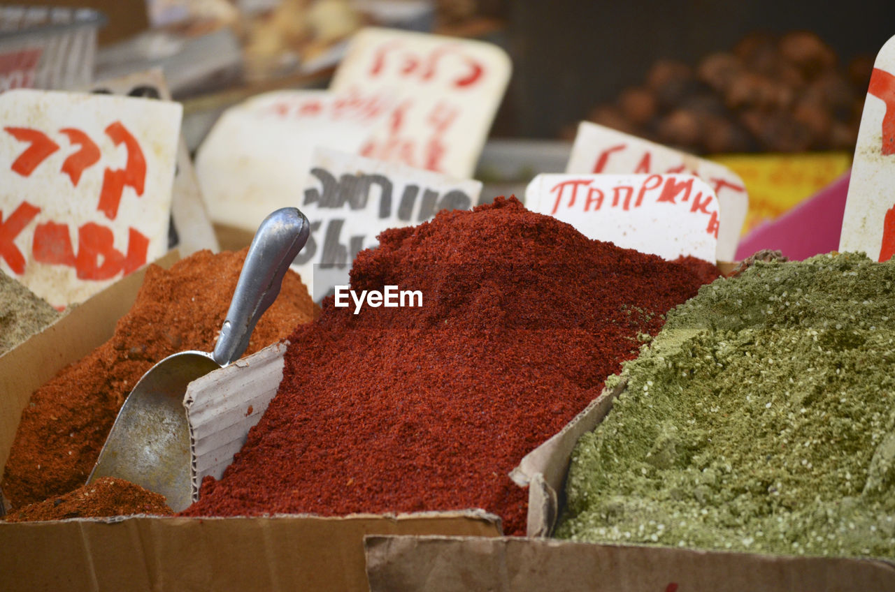 food, food and drink, freshness, market, retail, text, no people, for sale, spice, indoors, choice, price tag, close-up, variation, still life, western script, small business, business, market stall, ground - culinary, retail display, temptation