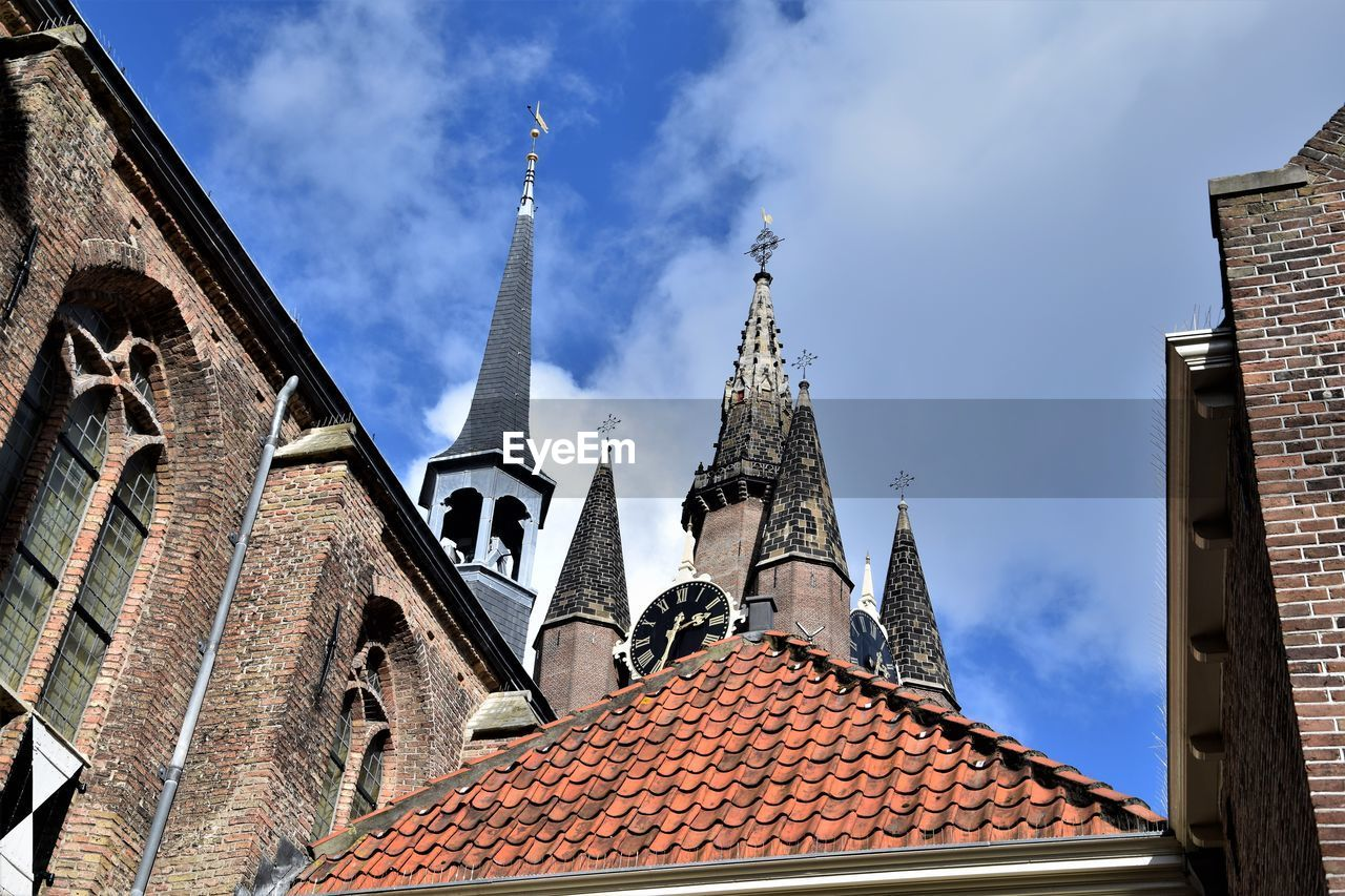 architecture, built structure, building exterior, building, place of worship, sky, religion, belief, spirituality, roof, cloud - sky, nature, tower, low angle view, day, city, travel destinations, roof tile, no people, outdoors, spire