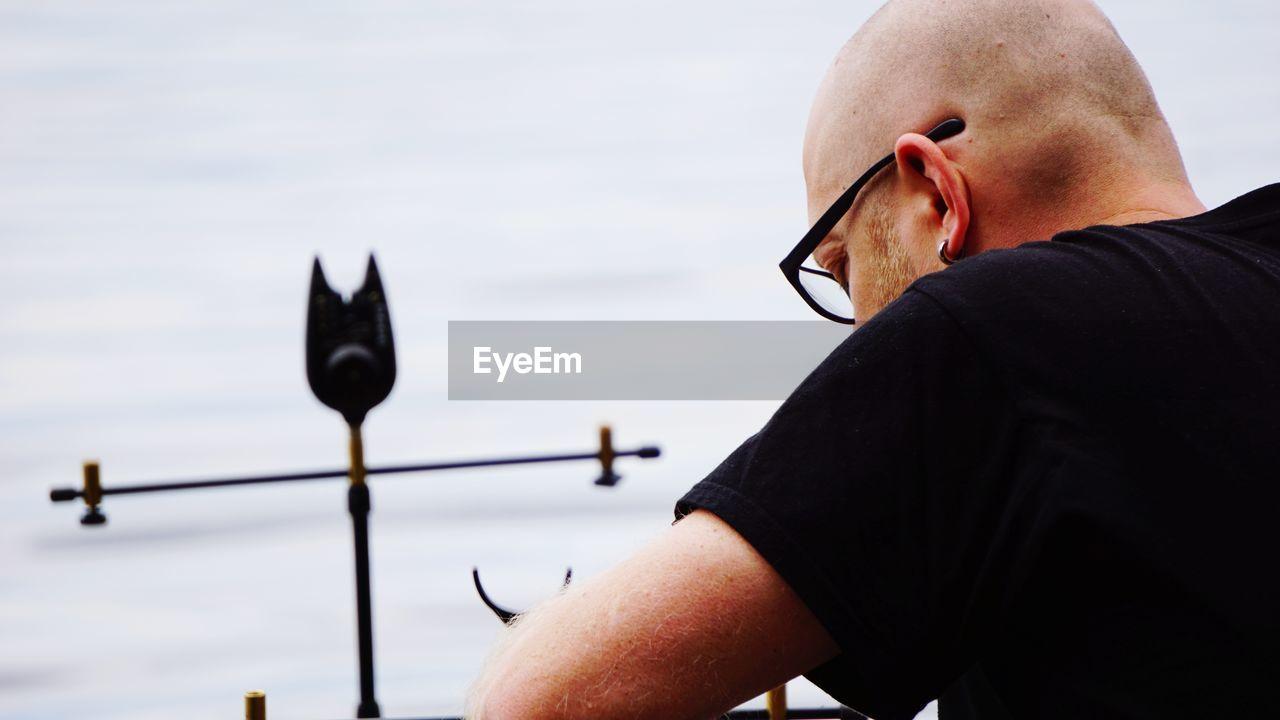 Close-Up Of Bald Man By Lake