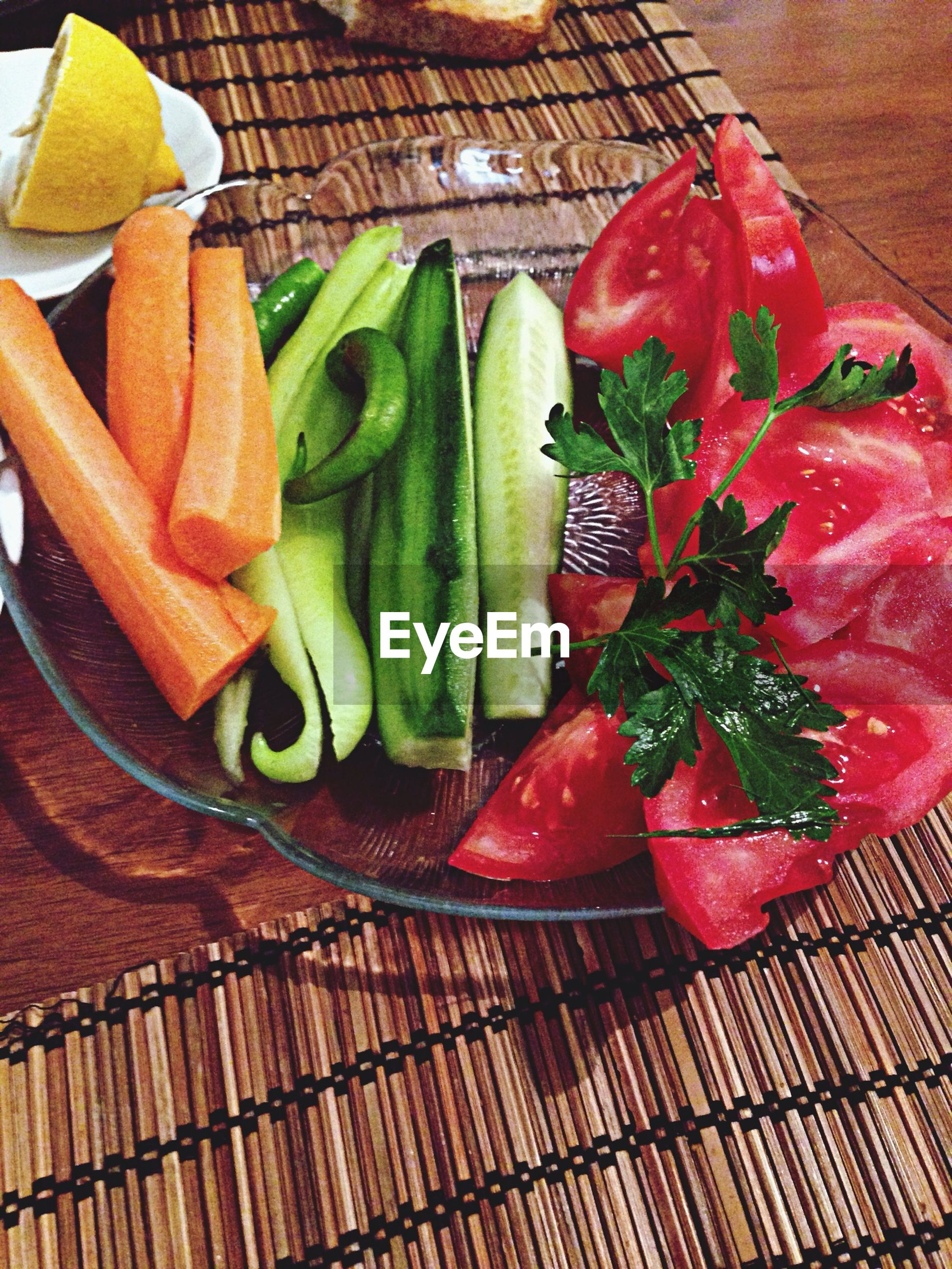 High angle view of vegetables in plate on table