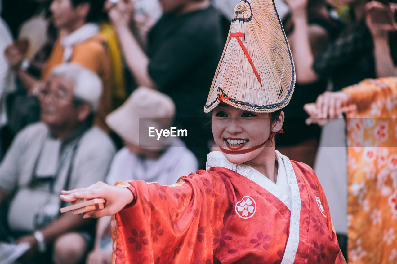 real people, focus on foreground, group of people, incidental people, celebration, men, arts culture and entertainment, lifestyles, traditional clothing, leisure activity, people, clothing, event, traditional festival, day, adult, waist up, performance, festival