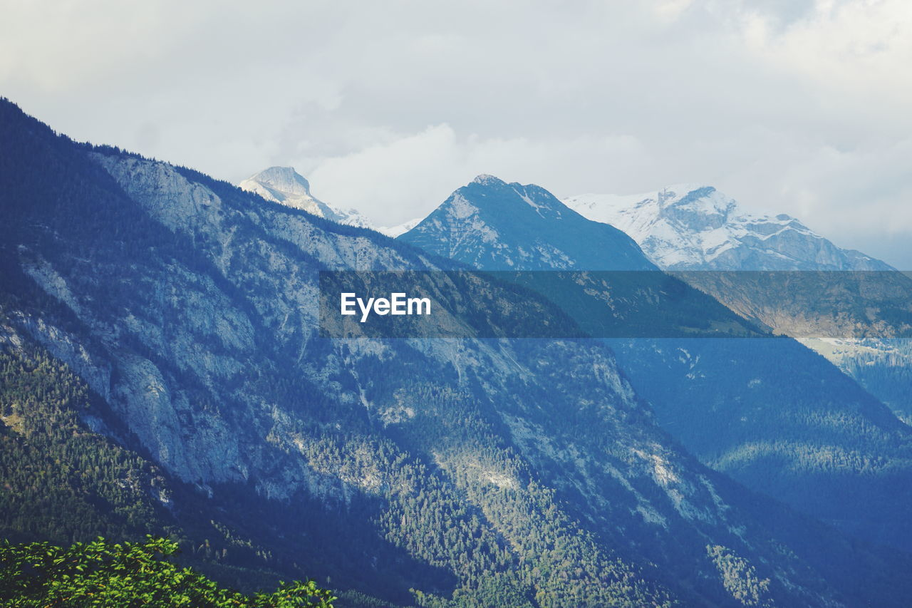 mountain, beauty in nature, sky, scenics - nature, environment, cloud - sky, tranquil scene, nature, tranquility, landscape, non-urban scene, cold temperature, winter, no people, snow, mountain range, idyllic, remote, day, range, outdoors, snowcapped mountain, mountain peak