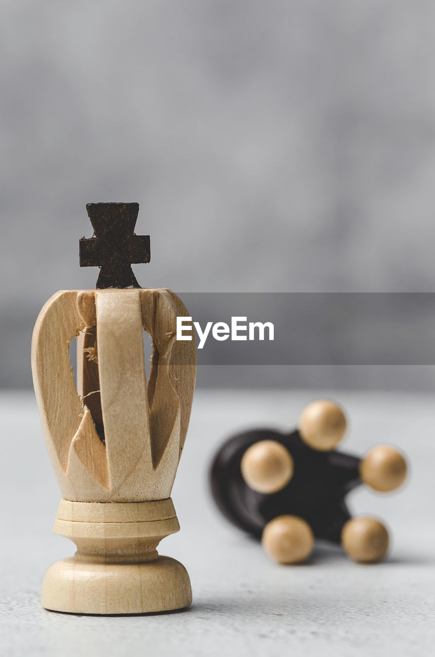 still life, table, no people, indoors, close-up, wood - material, focus on foreground, art and craft, selective focus, figurine, creativity, stack, craft, gray, representation, shape, decoration, design, stone - object, metal