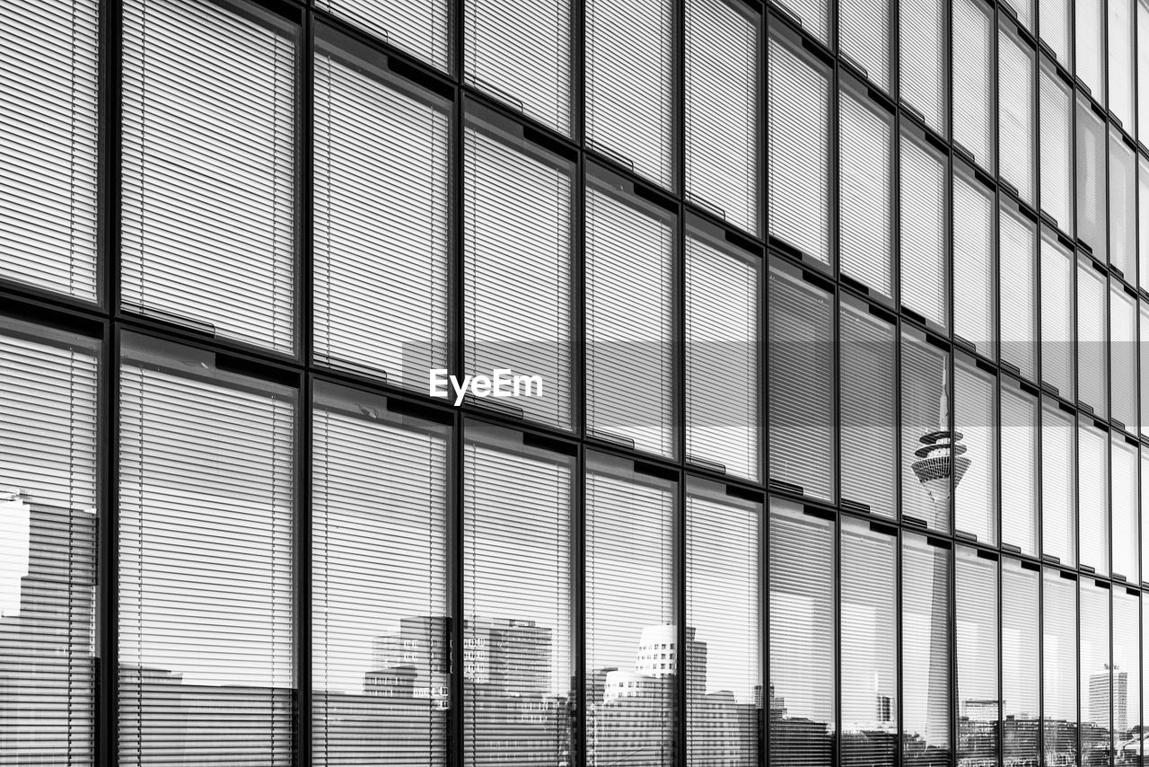 architecture, built structure, building exterior, building, pattern, city, modern, window, day, no people, low angle view, glass - material, full frame, outdoors, office, backgrounds, office building exterior, lighting equipment, design, shape, skyscraper, ceiling