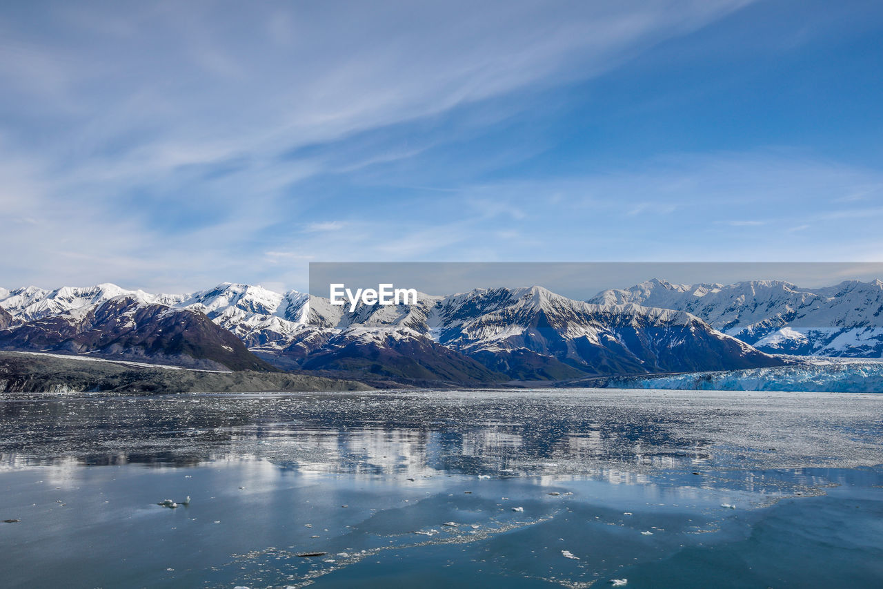 cold temperature, scenics - nature, beauty in nature, winter, mountain, water, sky, tranquil scene, cloud - sky, tranquility, waterfront, ice, mountain range, snow, lake, environment, idyllic, nature, no people, snowcapped mountain, outdoors, iceberg, range