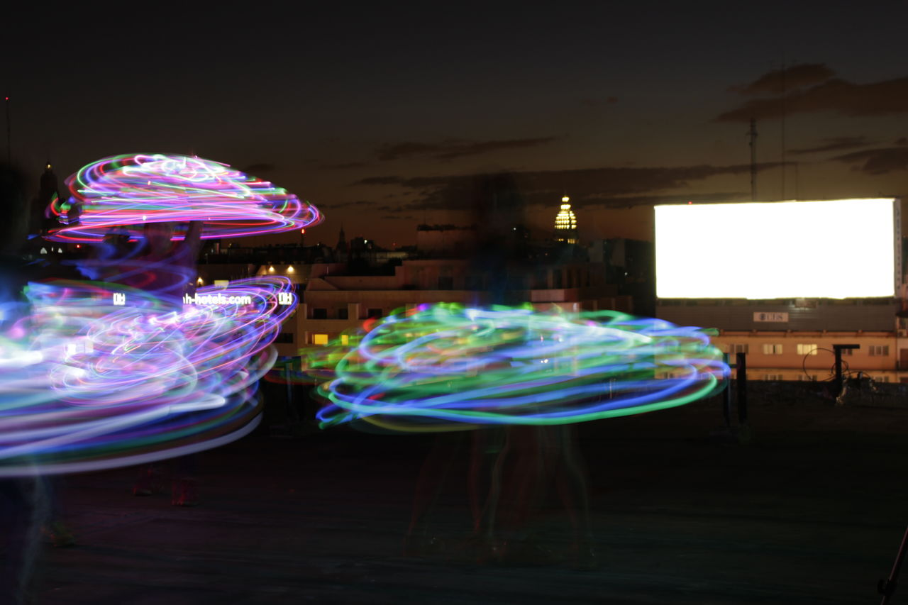 multi colored, illuminated, long exposure, night, motion, indoors, real people, architecture, sky