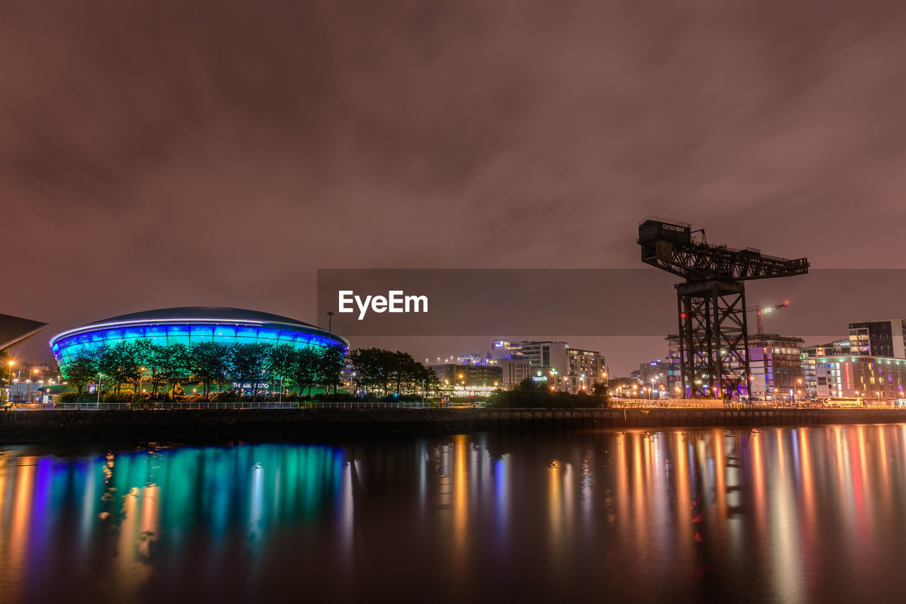 architecture, water, built structure, sky, illuminated, reflection, building exterior, night, waterfront, nature, cloud - sky, no people, city, long exposure, building, outdoors, travel destinations, industry, river