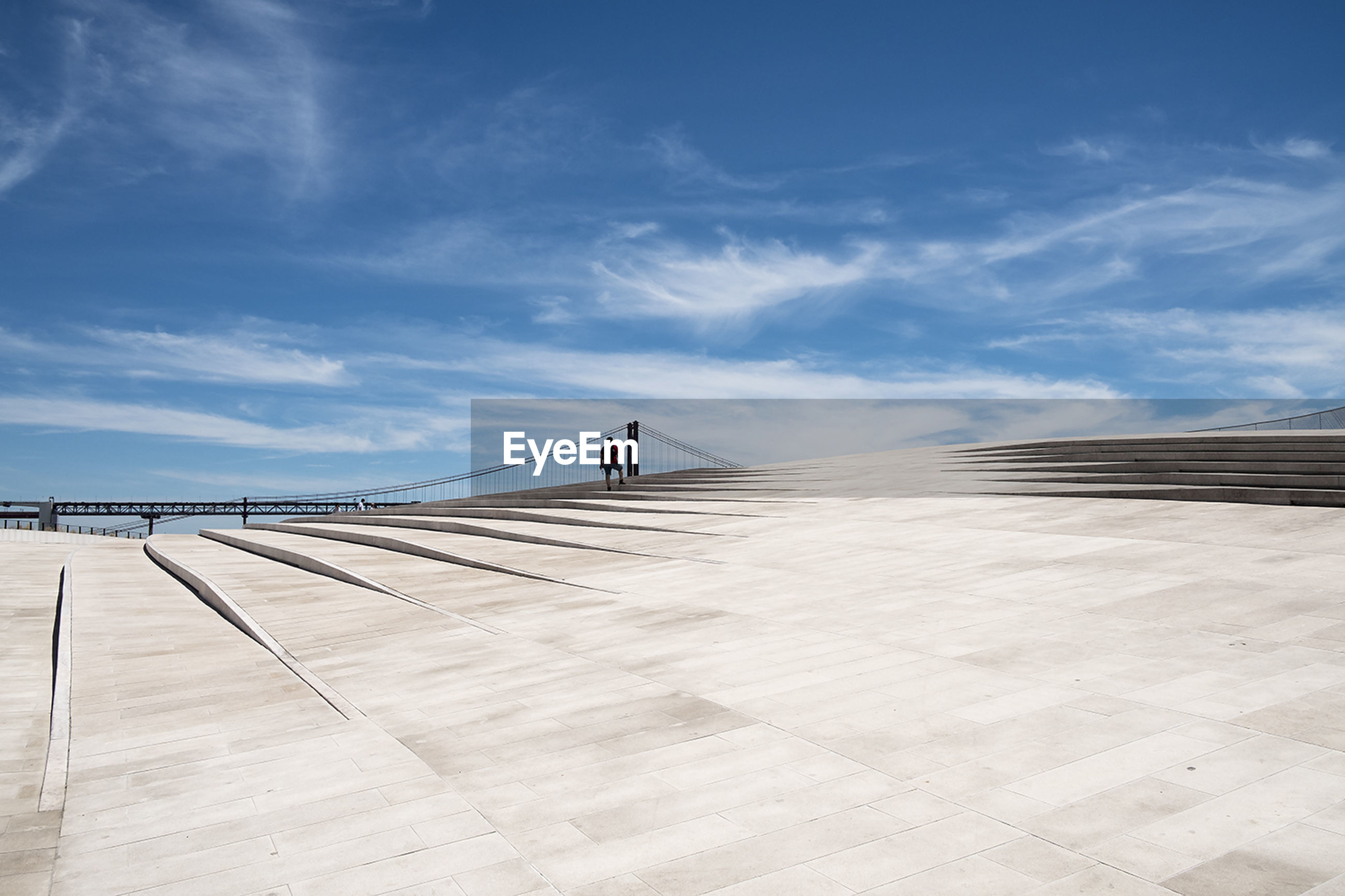 Distant view of person at maat museum against blue sky during sunny day