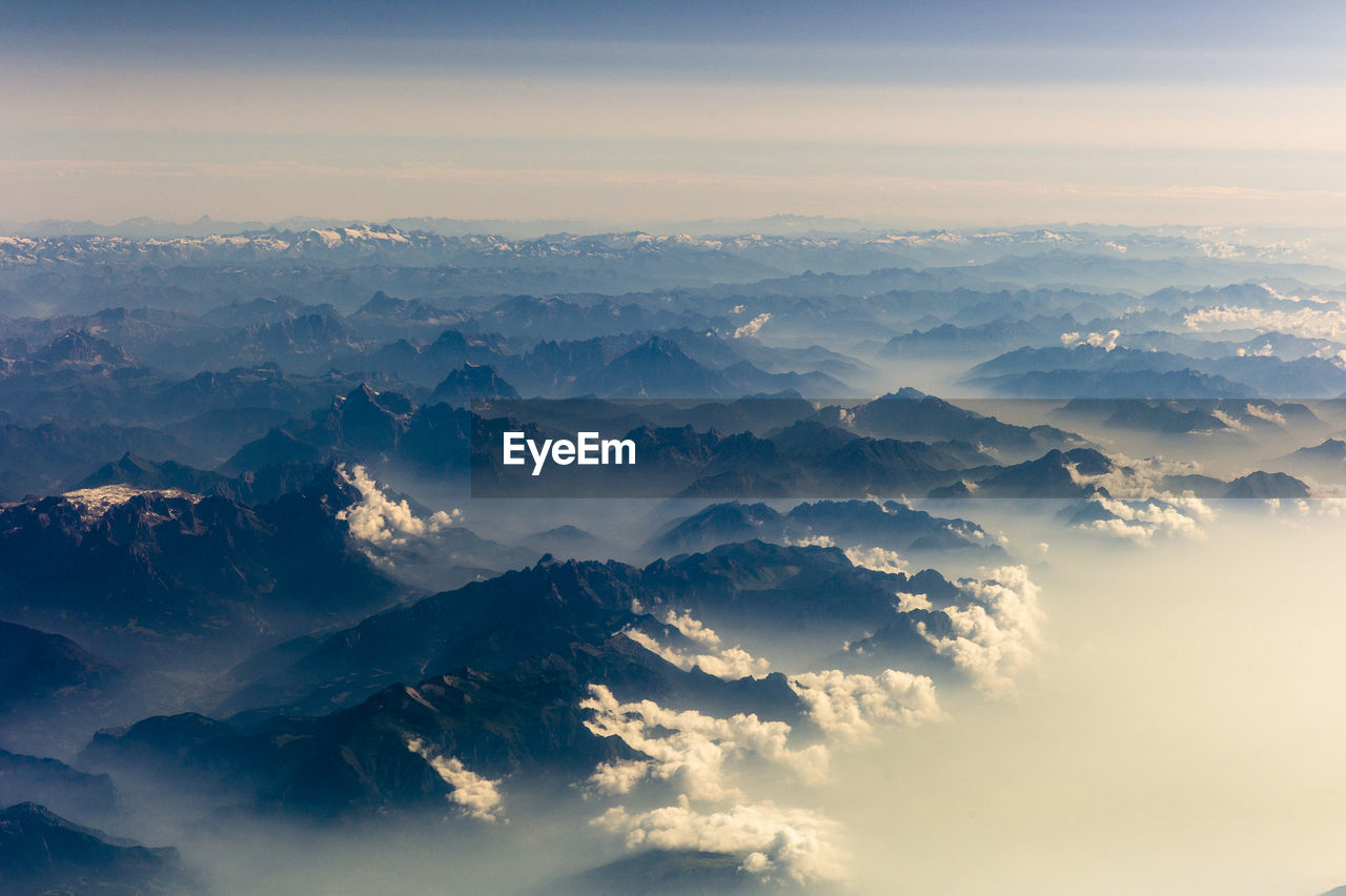 Aerial view of mountains against sky during sunrise