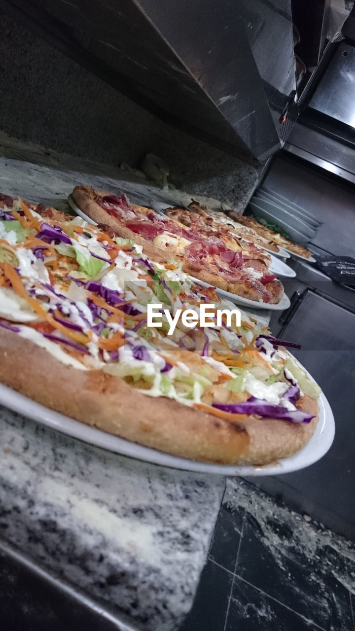 food, food and drink, pizza, ready-to-eat, freshness, indoors, table, high angle view, preparation, indulgence, no people, plate, unhealthy eating, pizza box, close-up, fast food, day