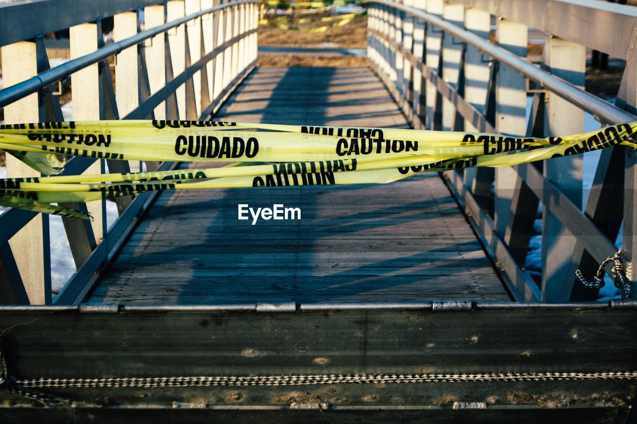 Caution tape on bridge