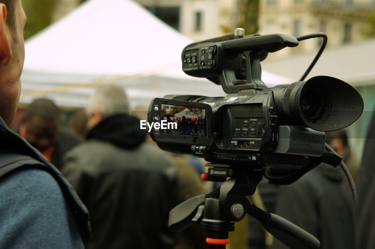 Close-Up Of Camera Against Blurred People
