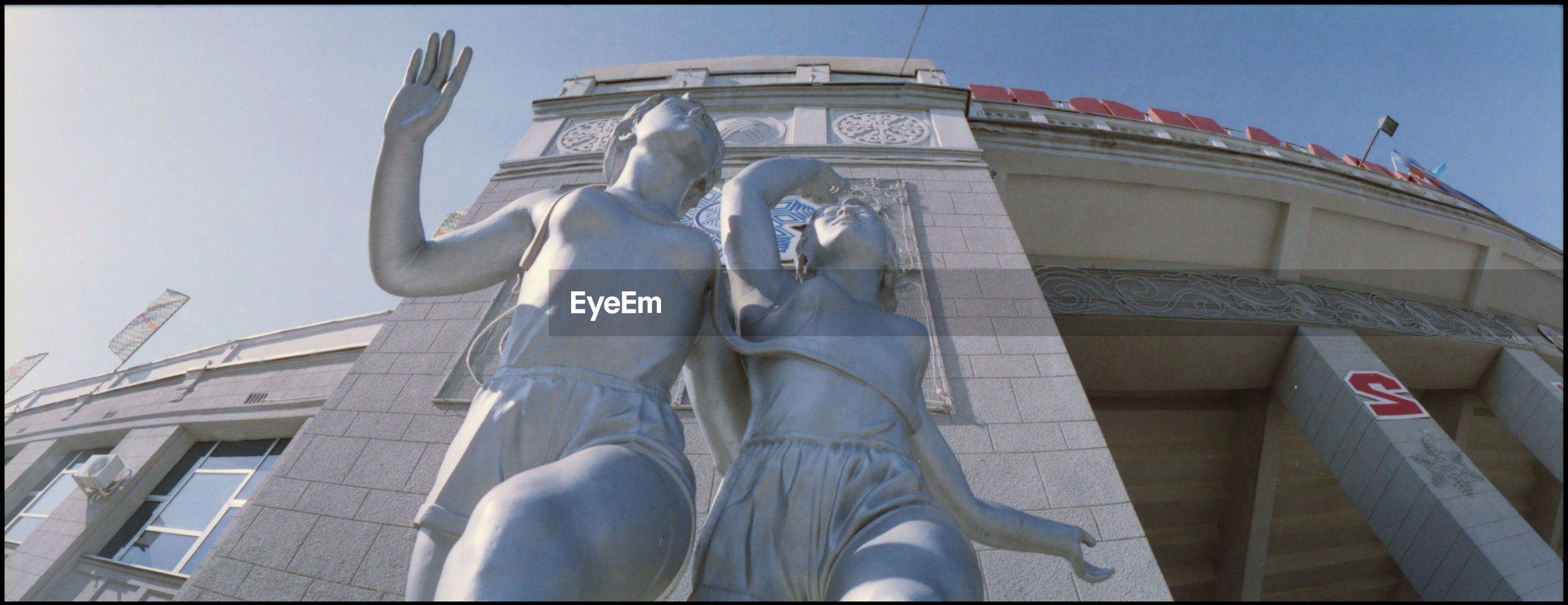 Low angle view of sliver statues outside building