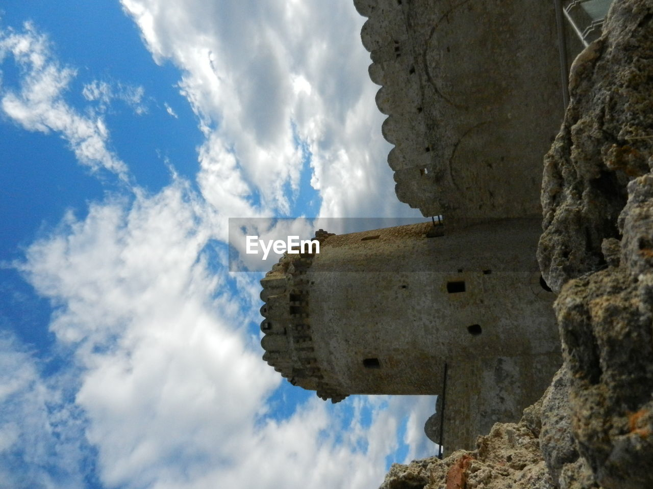 cloud - sky, history, sky, religion, the past, ancient, spirituality, day, old ruin, low angle view, architecture, place of worship, statue, built structure, no people, sculpture, ancient civilization, travel destinations, outdoors, memorial, building exterior, nature, beauty in nature, close-up