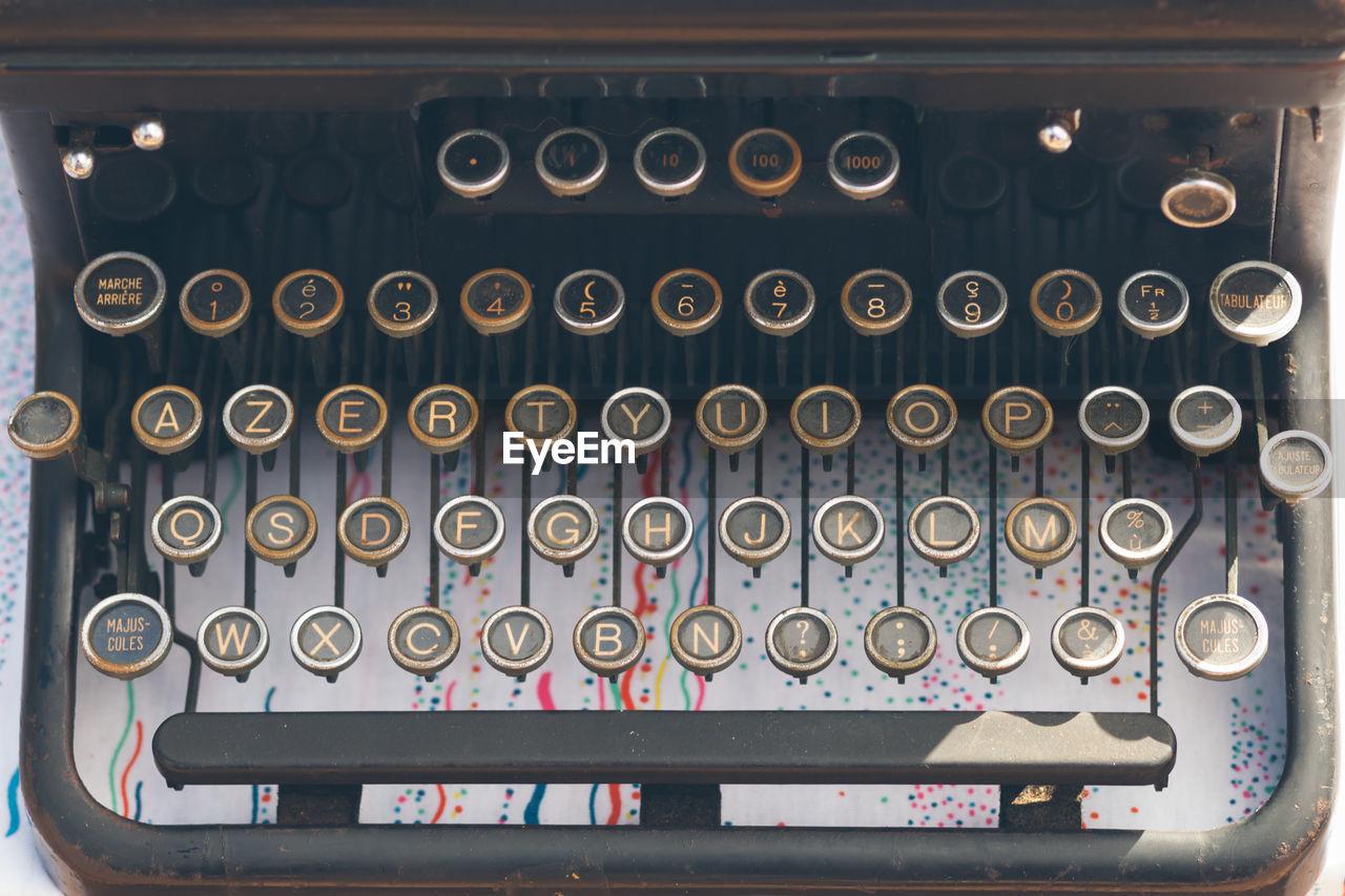 High angle view of antique typewriter keyboard