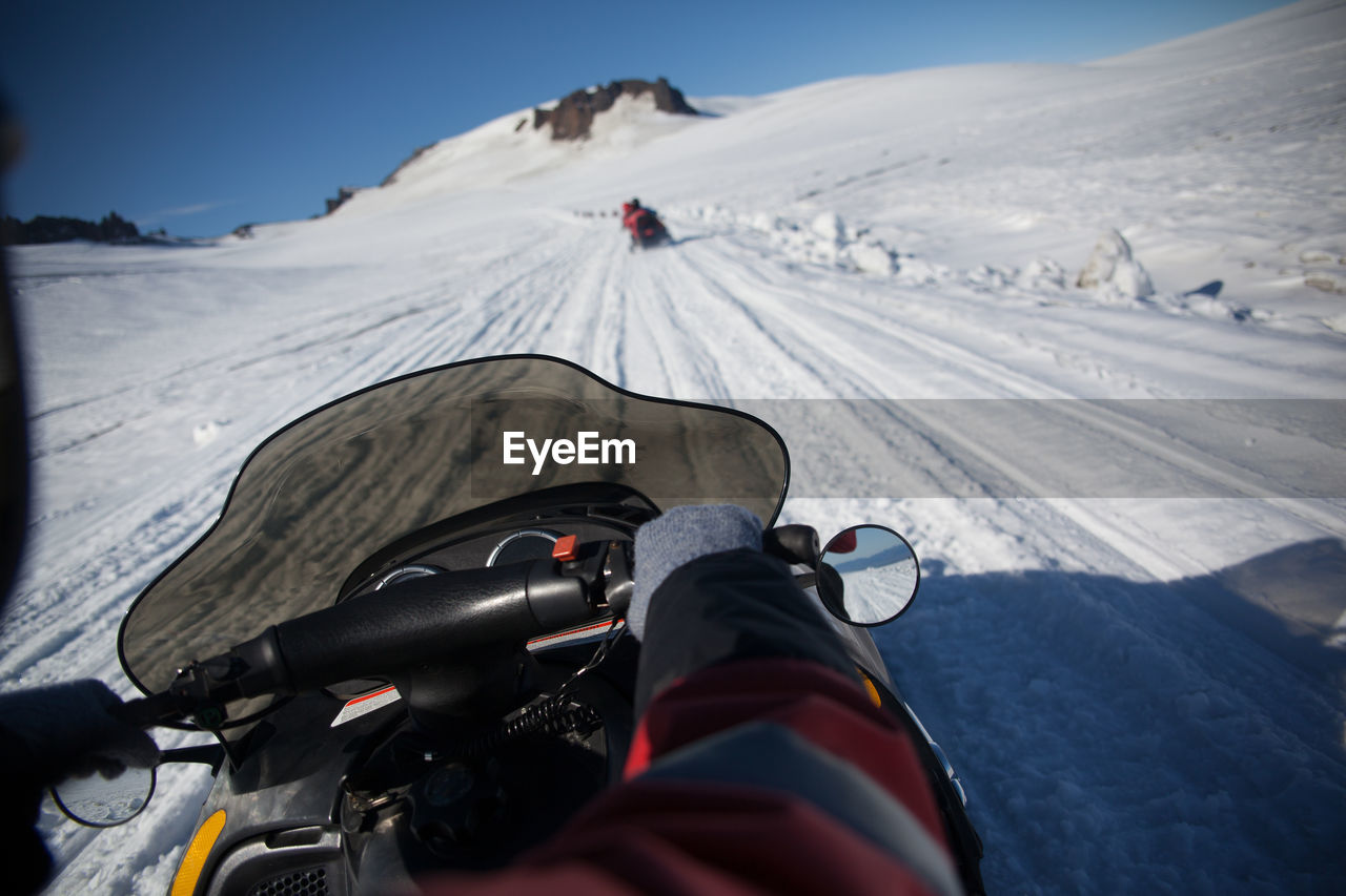 Cropped Image Of Person Riding On Snowmobile