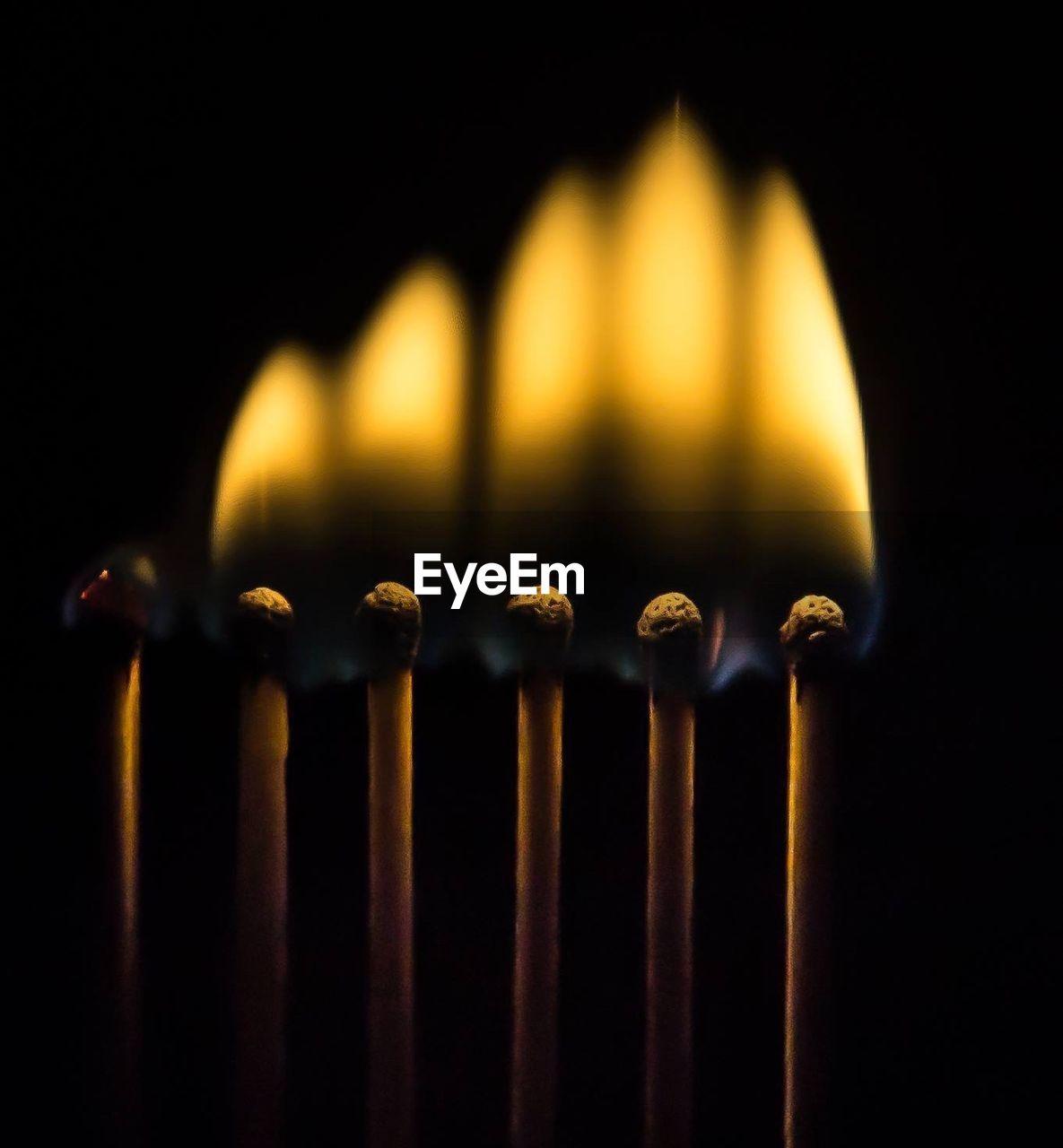 Close-up of illuminated matchsticks