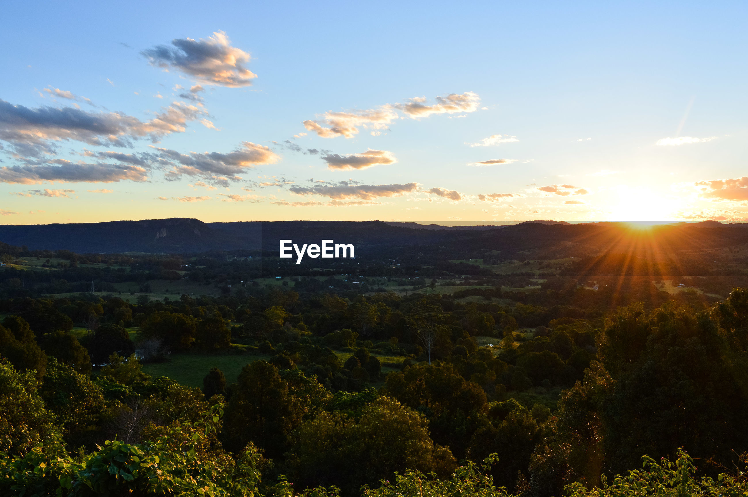 SCENIC VIEW OF SUNSET OVER LANDSCAPE