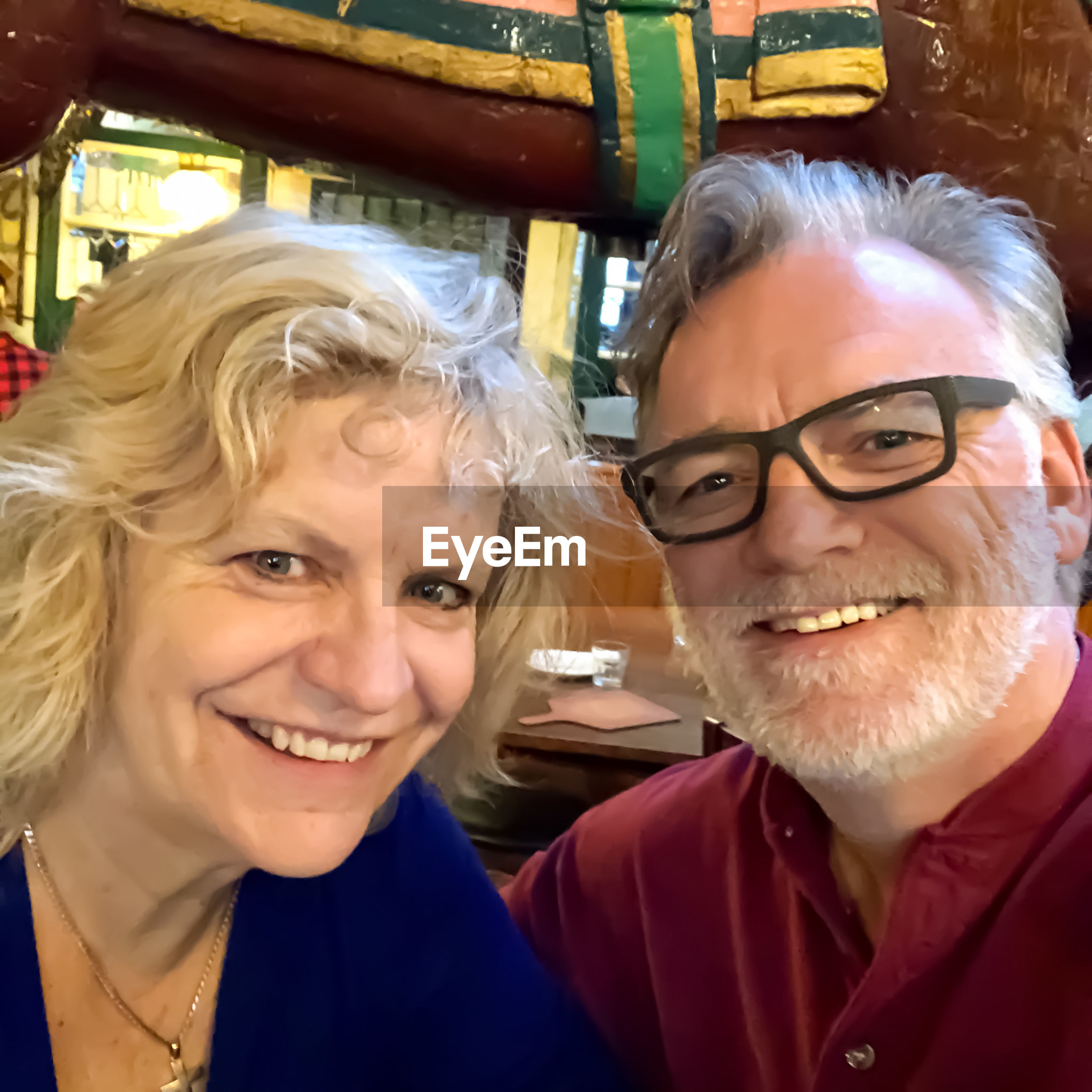 Portrait of smiling man and woman in restaurant