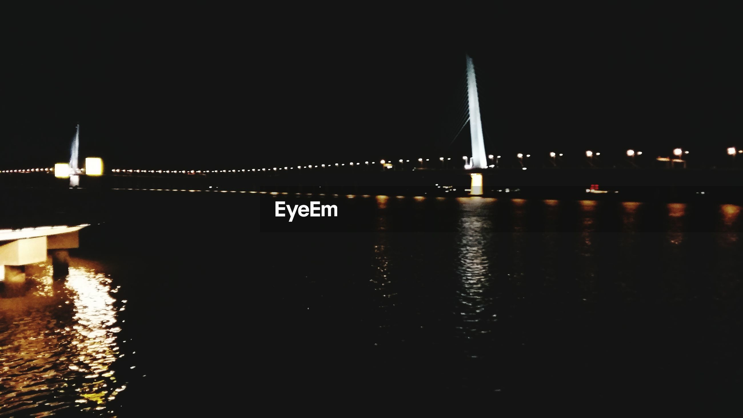 night, illuminated, architecture, built structure, water, building exterior, waterfront, river, reflection, city, clear sky, bridge - man made structure, connection, copy space, transportation, travel destinations, outdoors, no people, bridge, travel