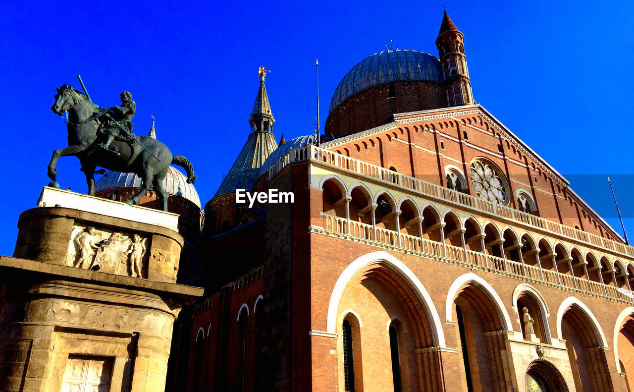 Low angle view of basilica of saint anthony of padua against clear blue sky
