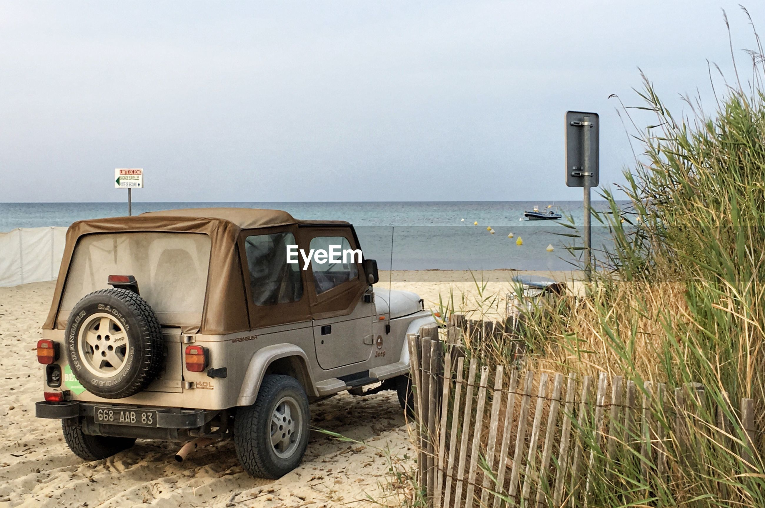 VINTAGE CAR ON BEACH