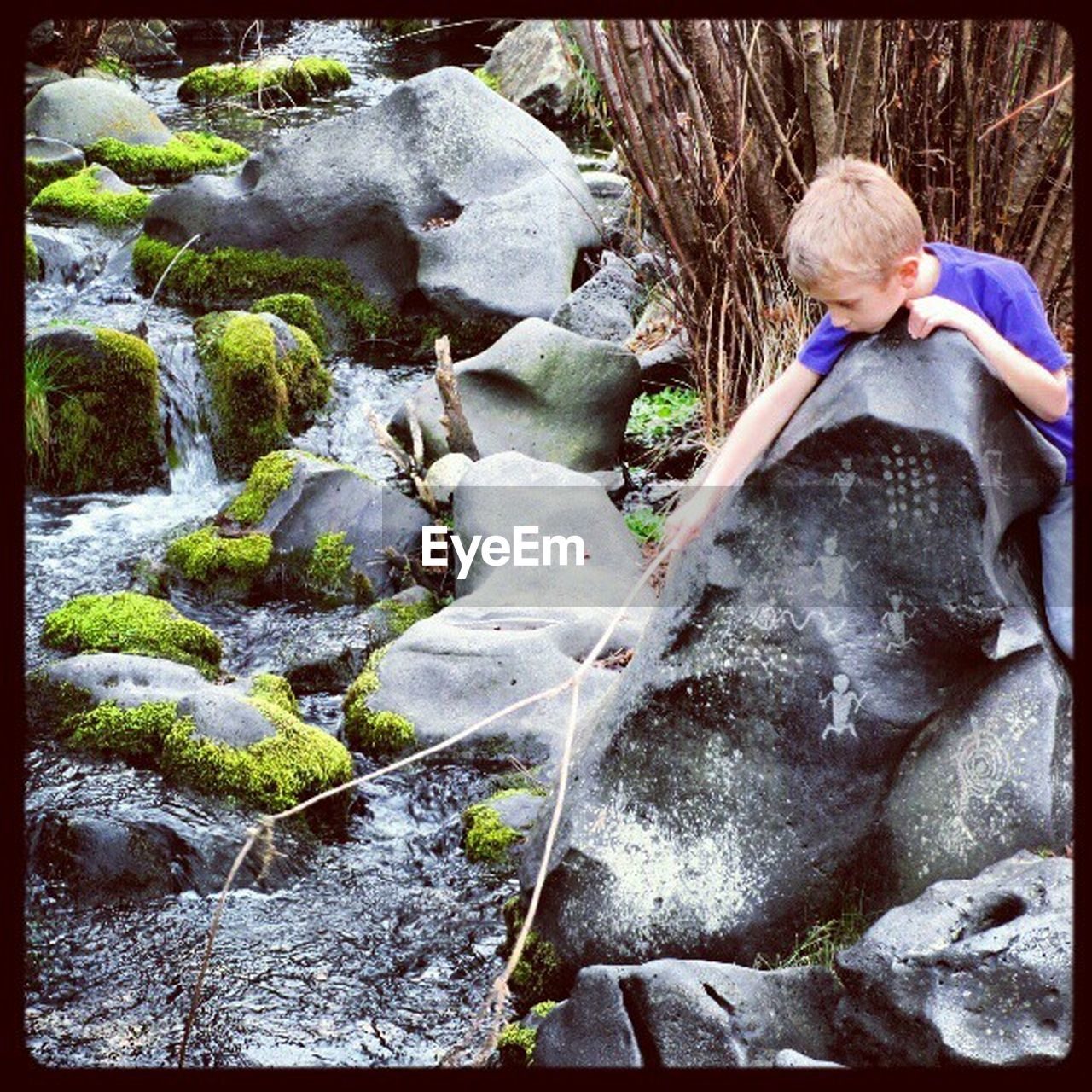 childhood, rock - object, one person, water, day, outdoors, waterfall, boys, real people, blond hair, motion, full length, children only, child, one boy only, climbing, nature, people