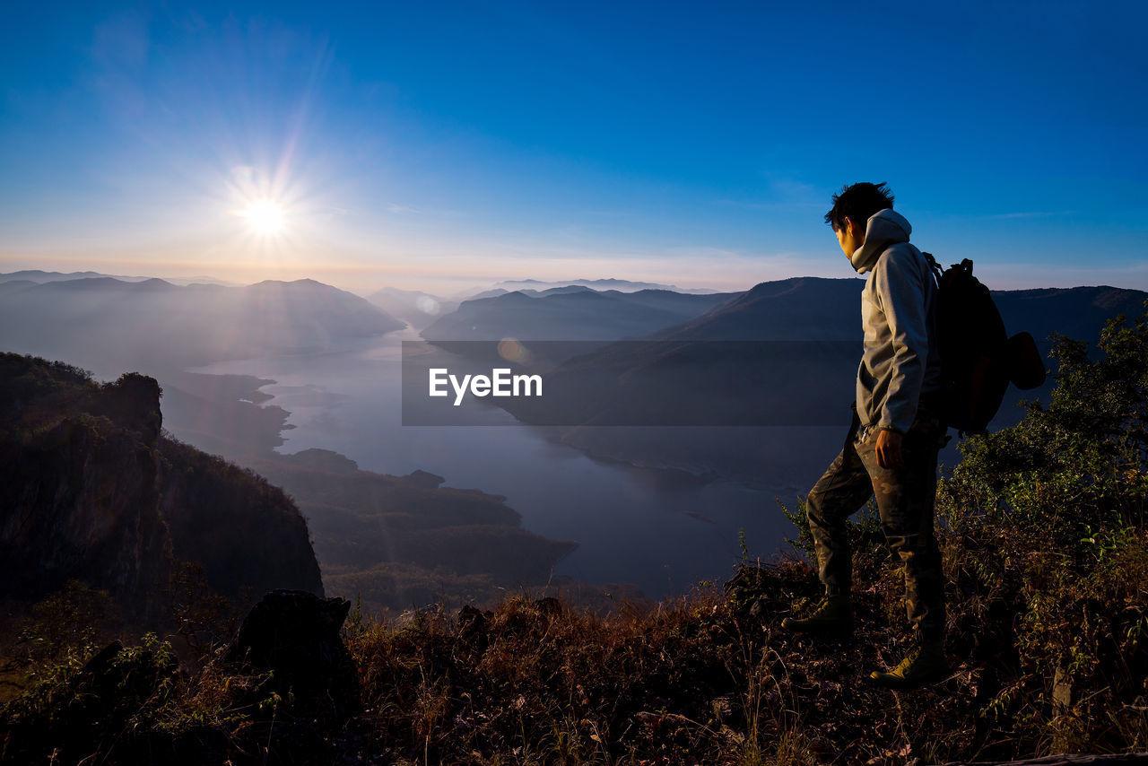 Man On Mountain At Sunrise
