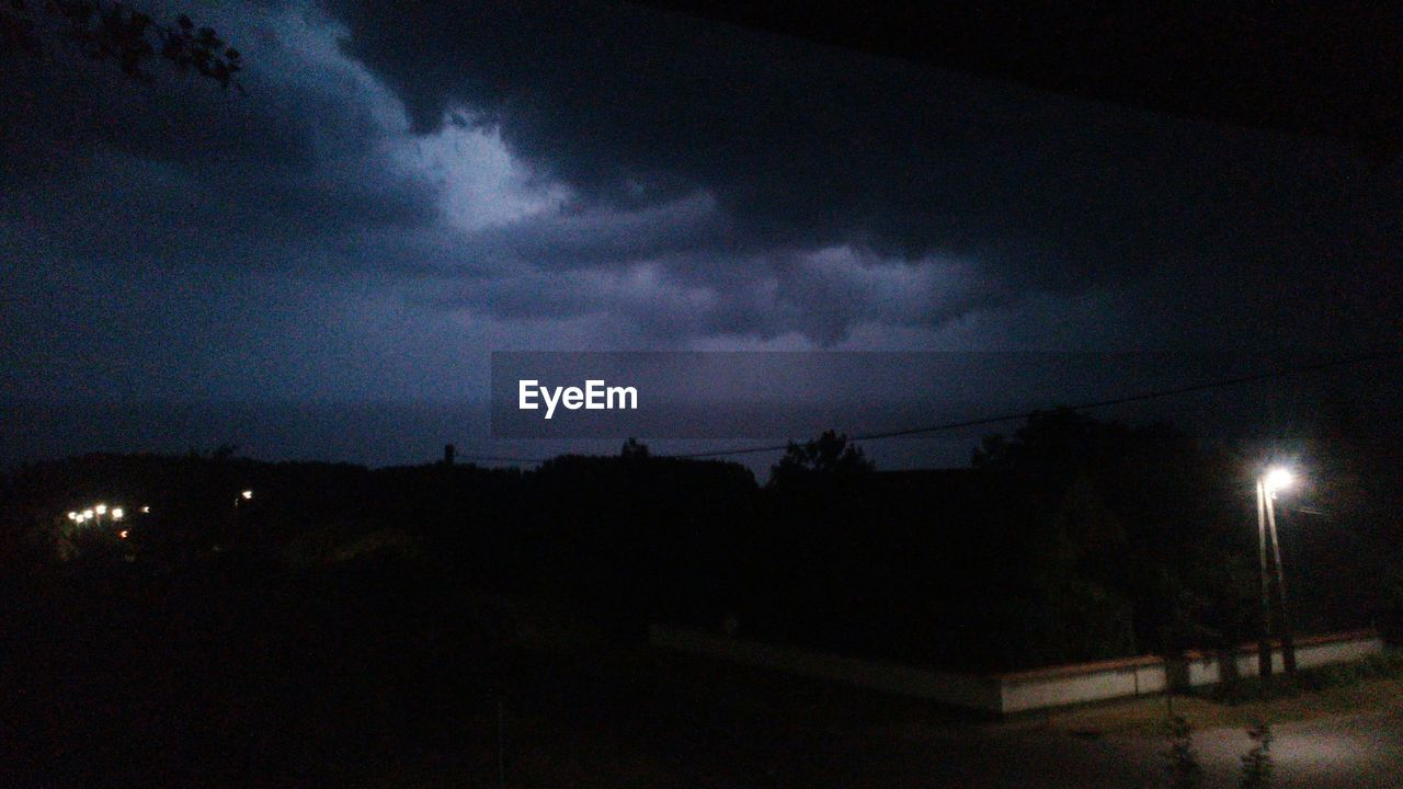 night, sky, dark, silhouette, illuminated, weather, nature, storm cloud, no people, cloud - sky, beauty in nature, outdoors, scenics, architecture, moon, built structure, building exterior, thunderstorm, lightning, forked lightning, astronomy