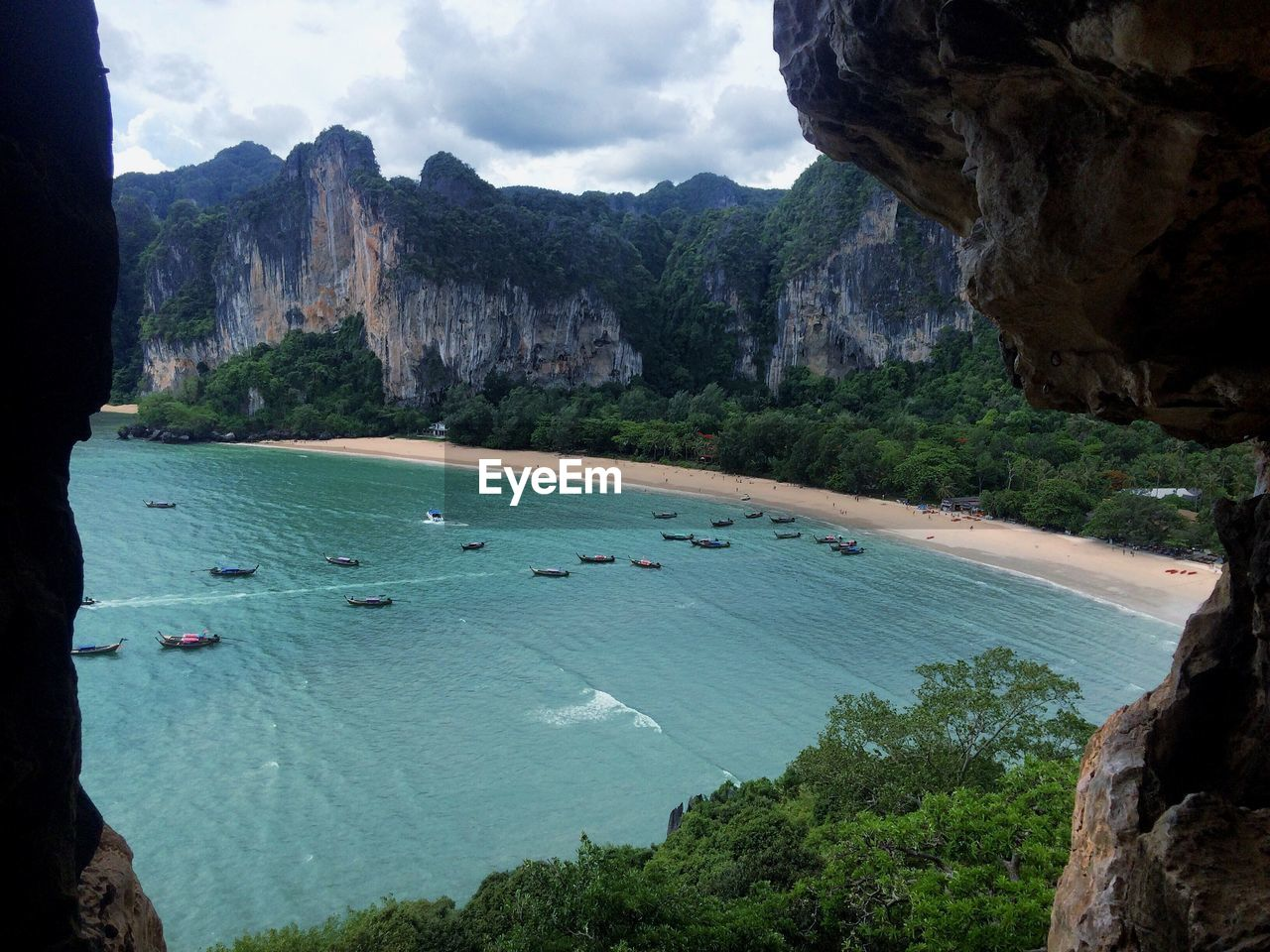 water, mountain, rock, sea, nature, rock formation, solid, day, rock - object, scenics - nature, beauty in nature, mountain range, tranquil scene, sky, land, tranquility, leisure activity, outdoors, group of people, formation
