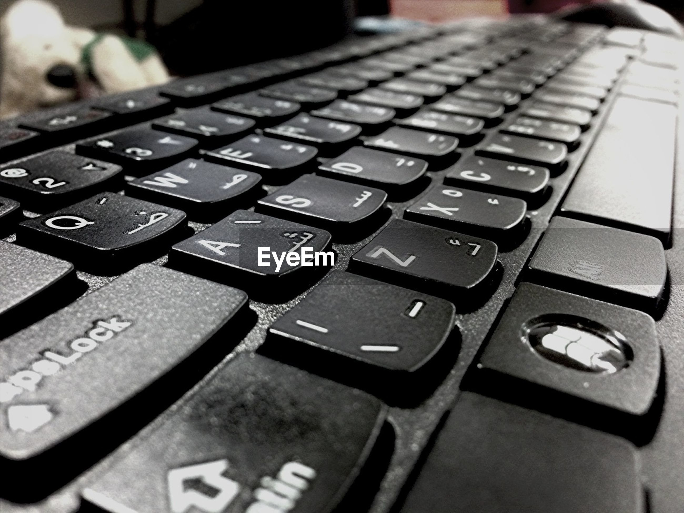 indoors, communication, close-up, computer keyboard, technology, wireless technology, number, connection, selective focus, text, focus on foreground, still life, laptop, western script, high angle view, computer, music, table, computer key, alphabet