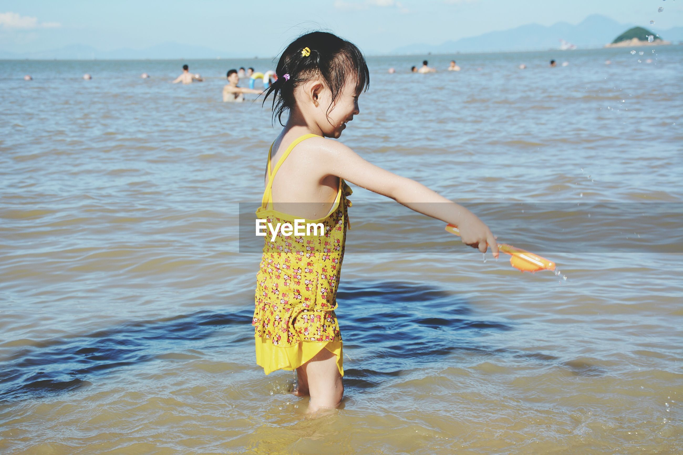 water, sea, beach, lifestyles, leisure activity, vacations, person, shore, wave, enjoyment, standing, full length, young women, horizon over water, girls, front view, childhood, bikini