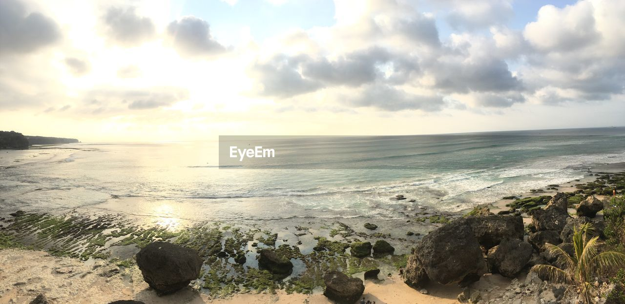 sea, sky, water, scenics - nature, beach, horizon, horizon over water, beauty in nature, rock, land, cloud - sky, tranquility, solid, rock - object, nature, tranquil scene, idyllic, no people, motion, outdoors, pebble
