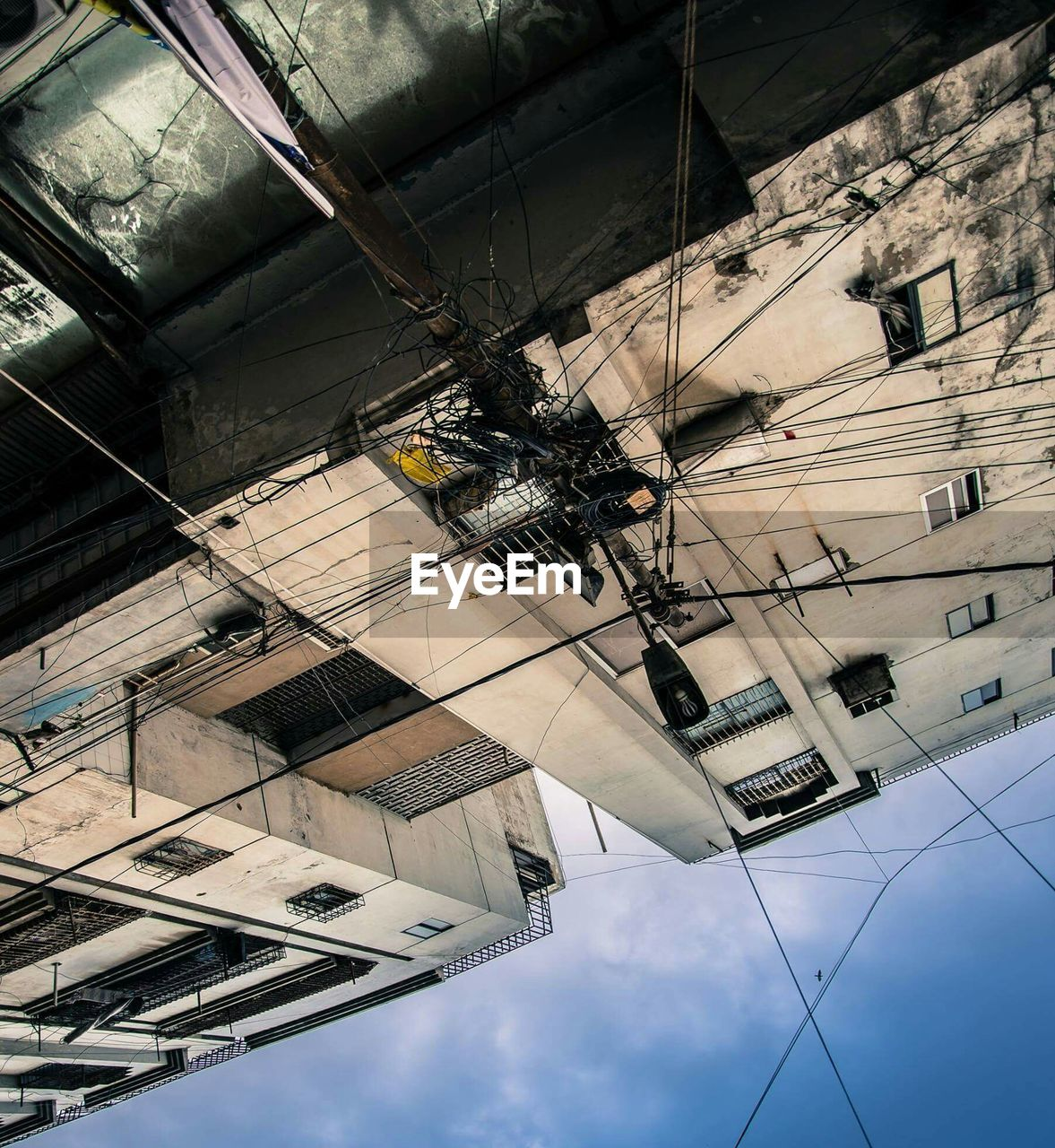 cable, low angle view, architecture, built structure, technology, day, building exterior, outdoors, no people, sky